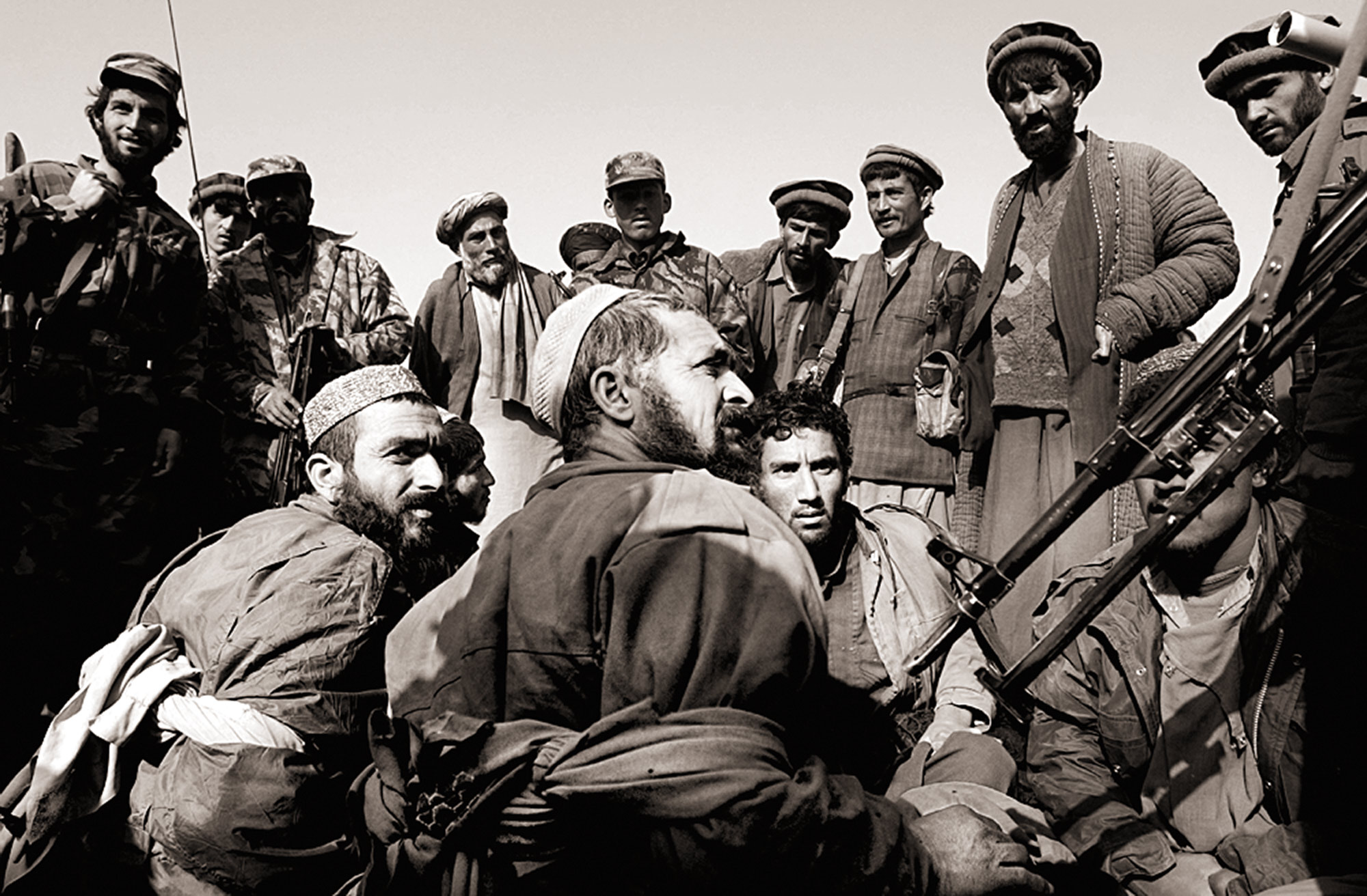 Taliban prisoners Esmatullah, Esmatullah and Abdulghafar plead for their lives from the Northern Alliance soldiers after their capture in Konduz, northern Afghanistan.