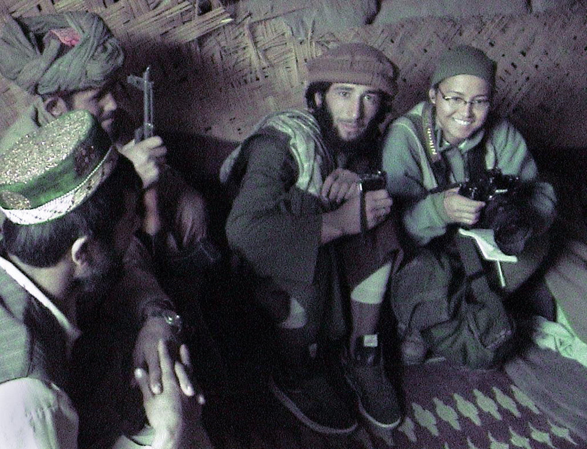 Days before German journalist Volker Handloik was killed in the vicinity of this bunker on the frontlines of Taliban-controlled territory, Cheryl Diaz Meyer is photographed by writer Tracey Eaton working with Northern Alliance soldiers in Puze Pulekhomri, Afghanistan, on Nov. 10, 2003.