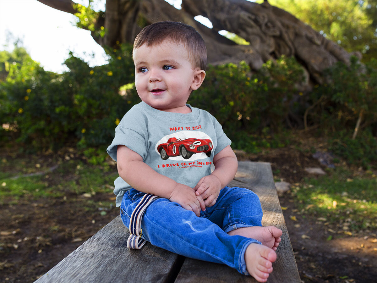 Babyboy with a light blue t-shirt with a cool car. Luckimi from @luckimibrand.