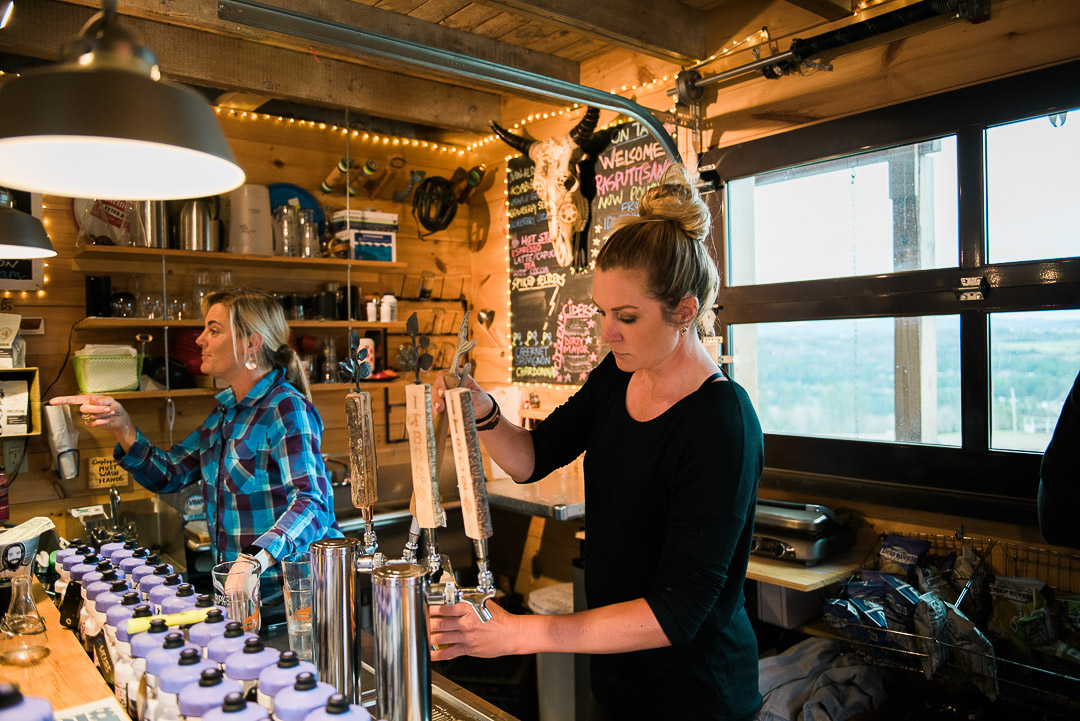 Carrie Tomcyzk, owner of The Hub Trailside, works the bar with pro cyclist, Alison Tetrick.