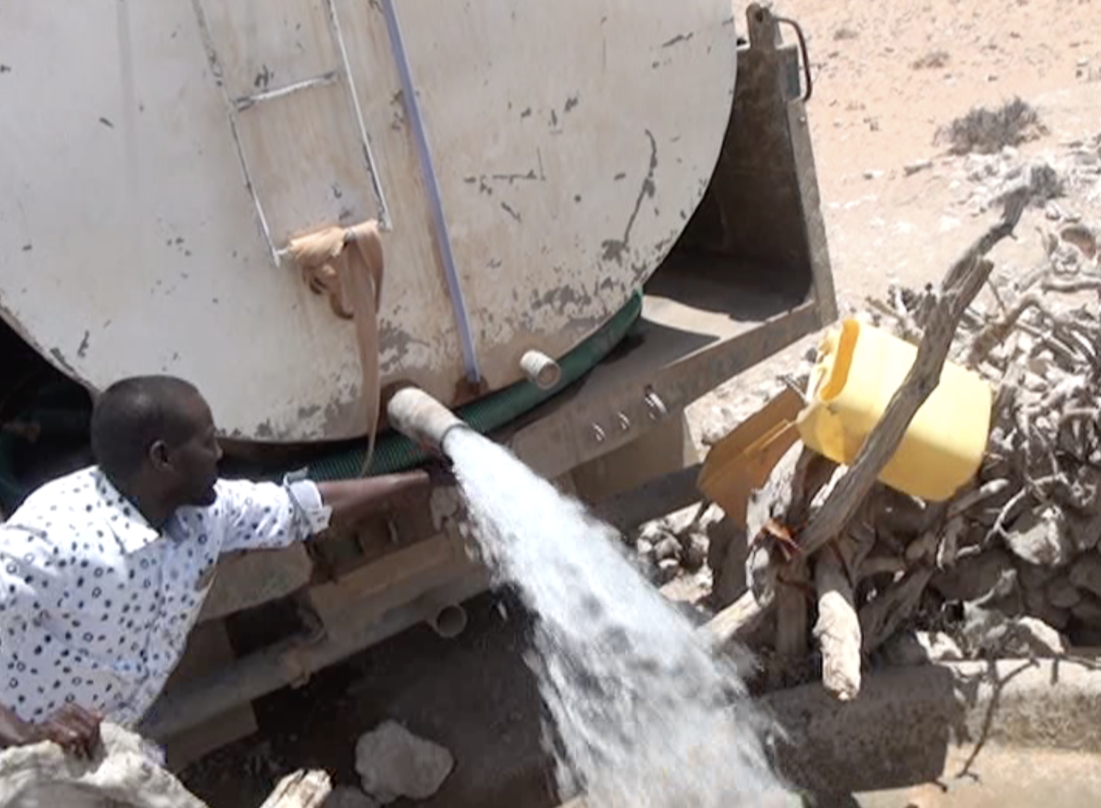 Water is put into the local village well