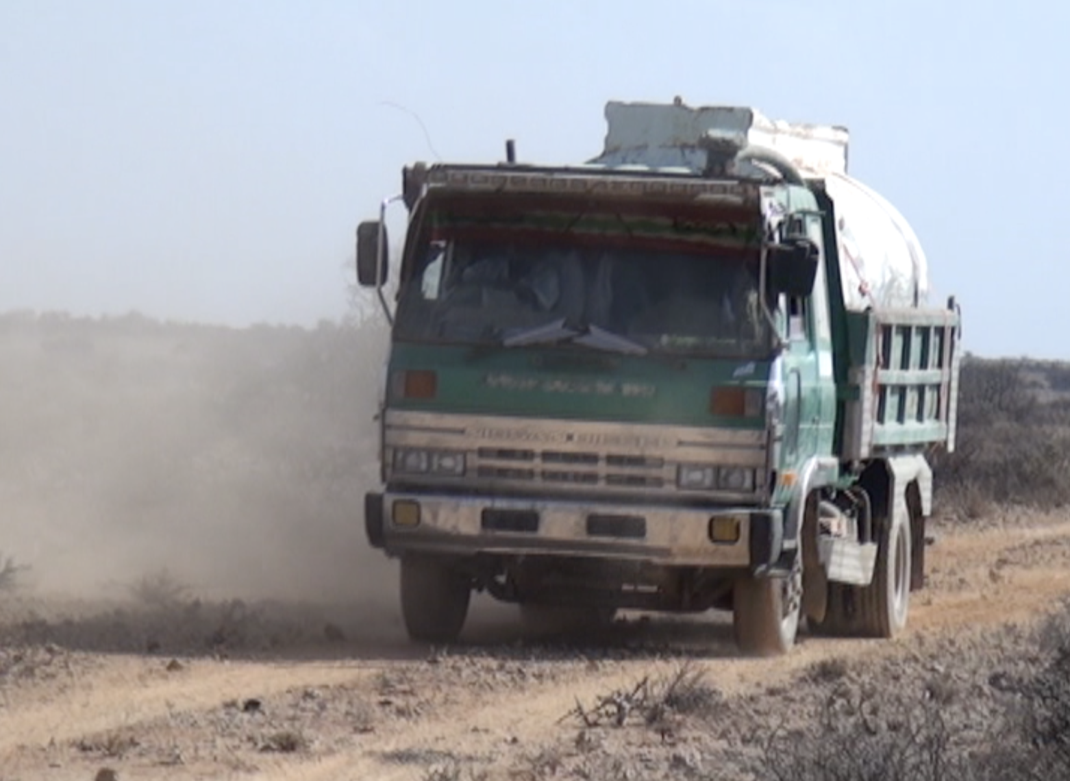 A tanker truck leaves to deliver water to a village