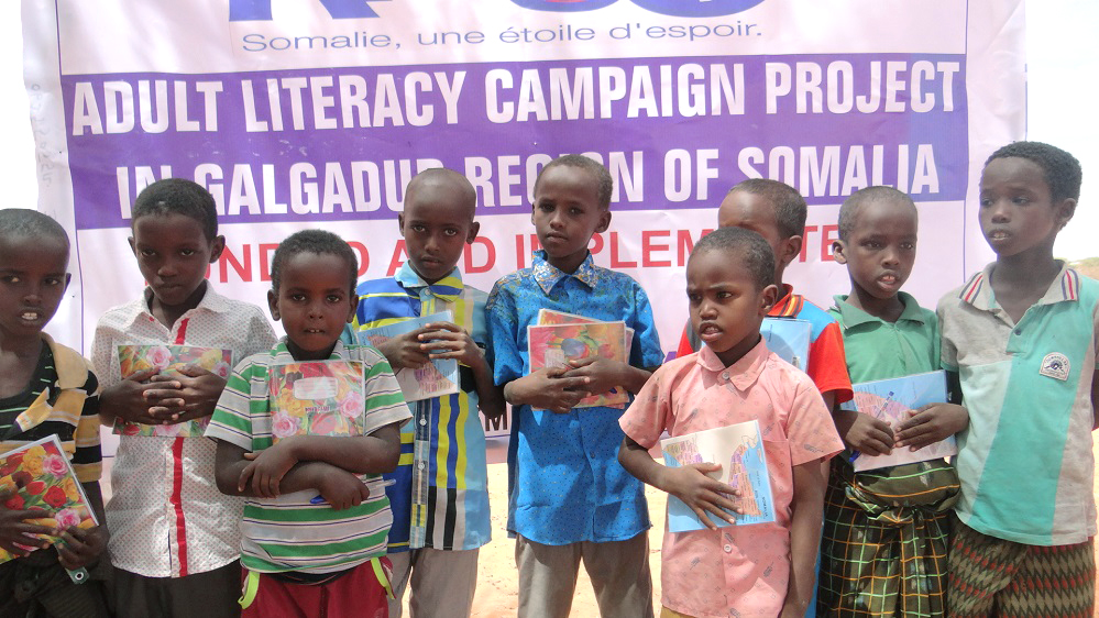 Young boys that have graduated from the literacy campaign project