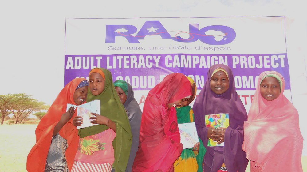 Young girls that have graduated from the literacy campaign project