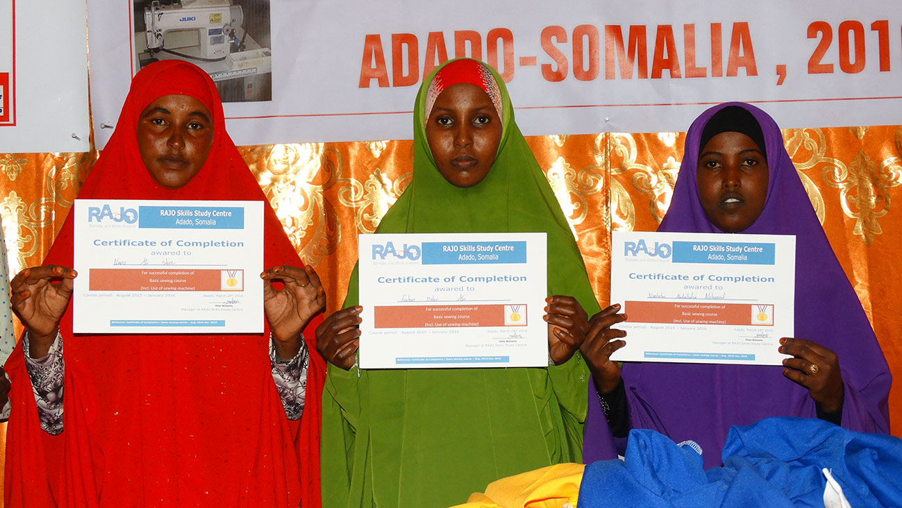 These three women have graduated from the 6 month sewing course