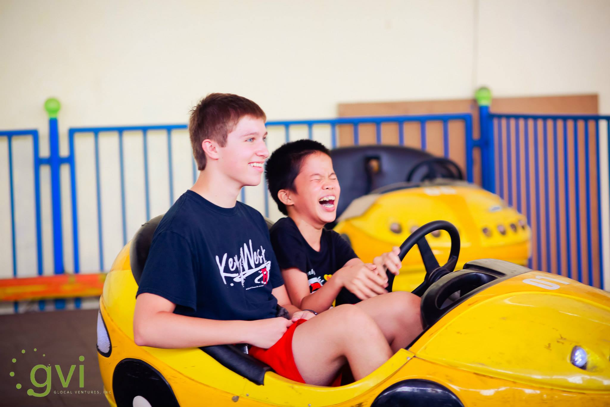 Huy and Weston in a bumper car during the first trip in 2015