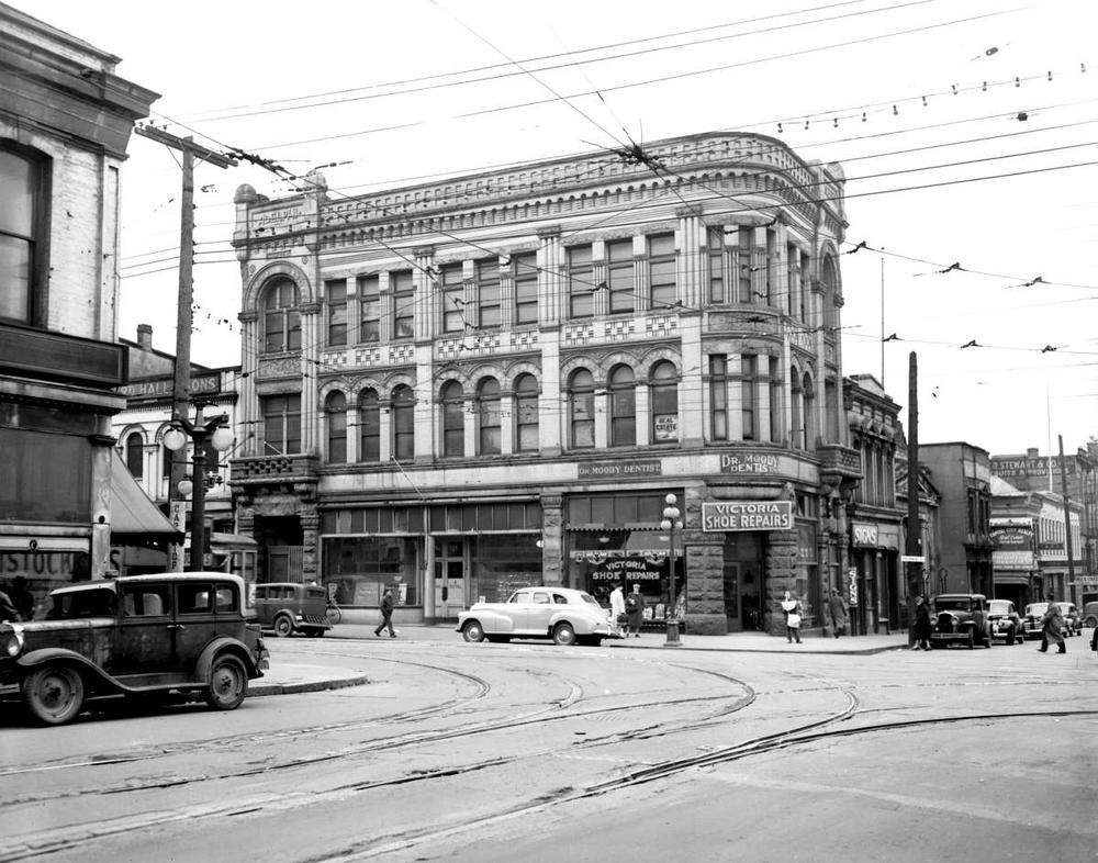 BC Archives Photo of the Adelphi Building (  https://search-bcarchives.royalbcmuseum.bc.ca/victoria-adelphi-building-on-southwest-corner-yates-and-government-streets-torn-down-for-p-leonard-james-post-office  )