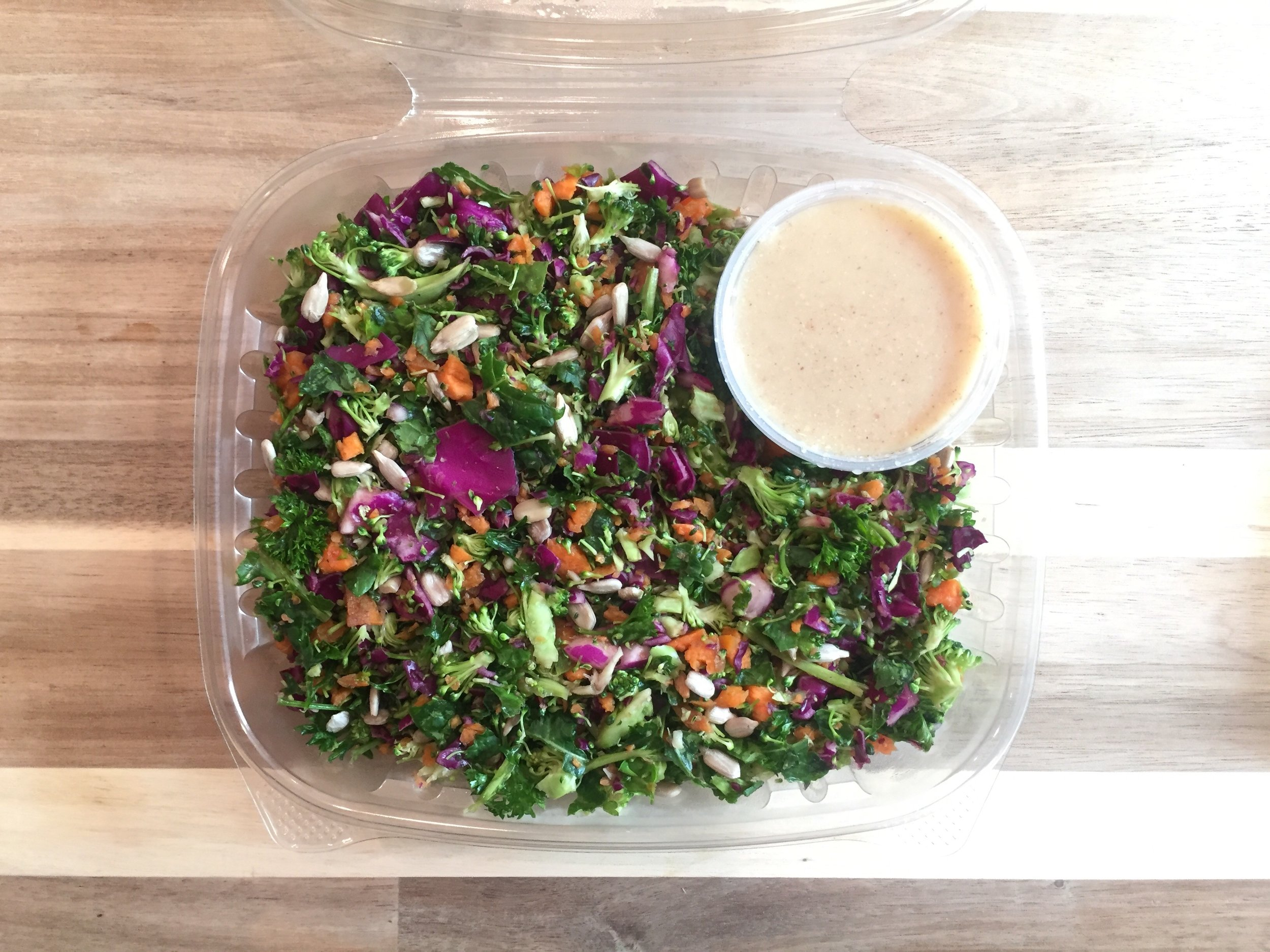 Raw Rainbow Salad - Broccoli, kale, cabbage, carrots, sunflower seeds, with lemon ginger dressing.