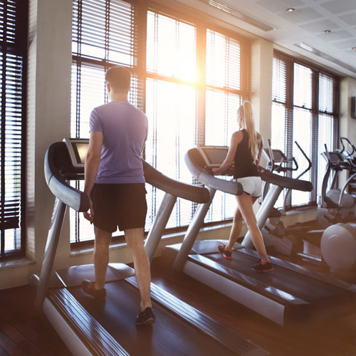 40375927-healthy-man-and-woman-running-on-a-treadmill-in-a-gym_500x500.jpg