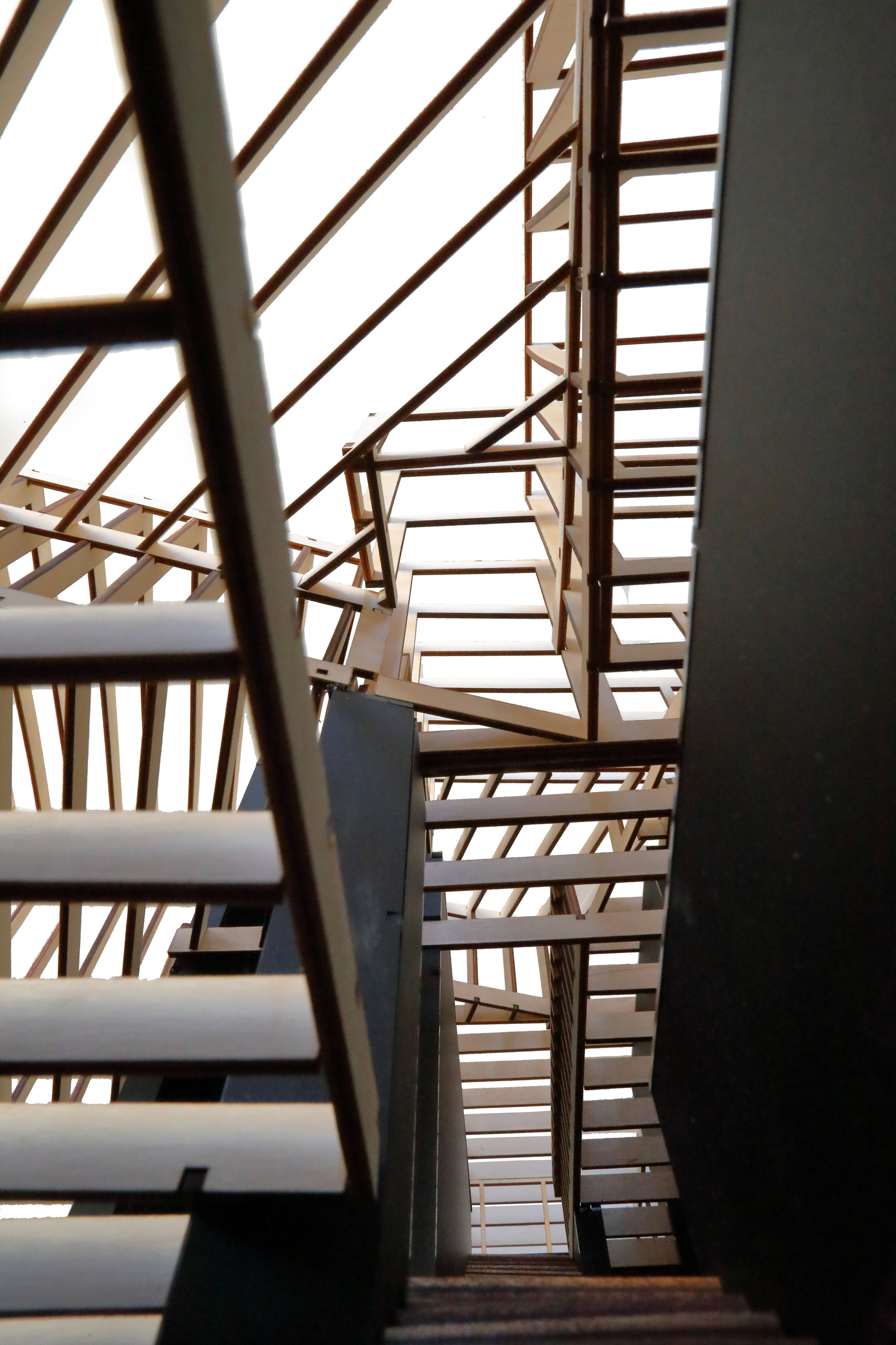 View up through all three floors showing optional top floor interior balcony