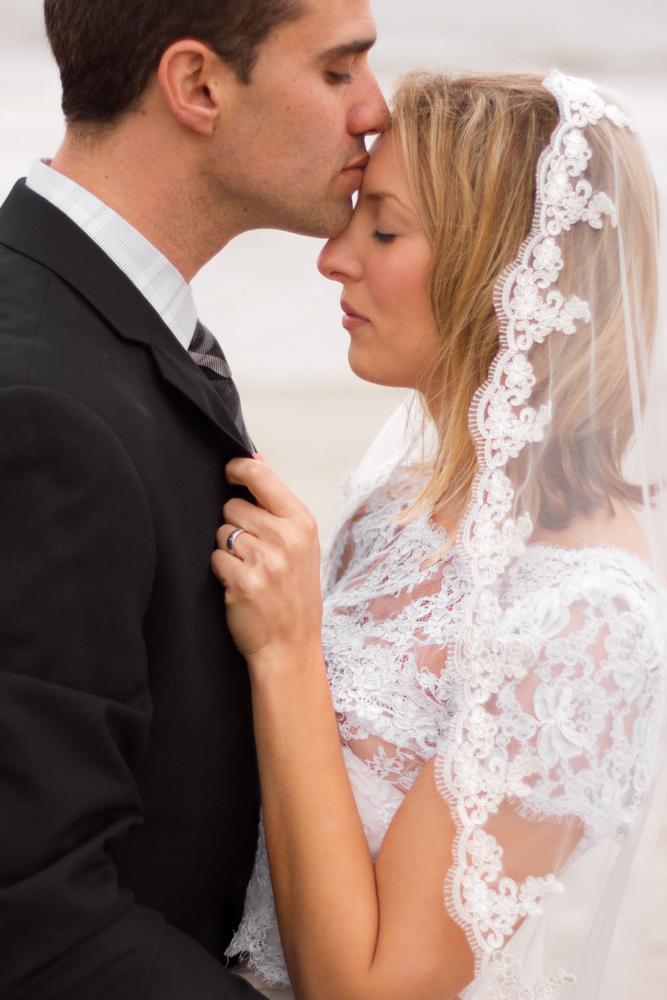 Husband-Kisses-Wife-Intimate-Wedding-Photography