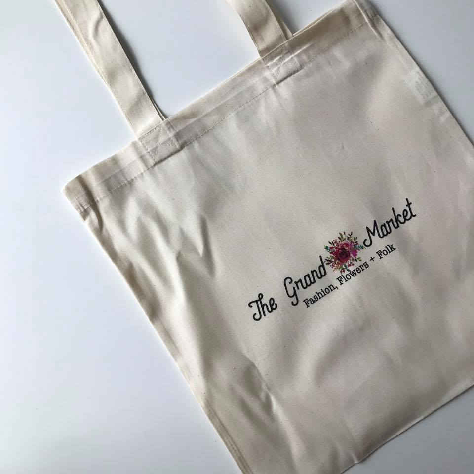 Tote bag holding all of the gifts given to the first 100 guests at the event on Sunday morning.
