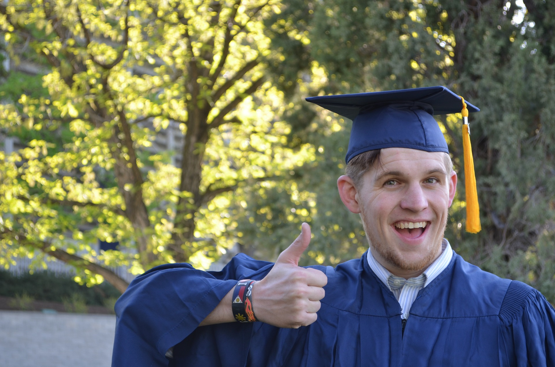 That cap and gown (which the college also made me pay for) were totally not worth it! Disclosure: that guy in the picture is not me. I was not nearly that happy.