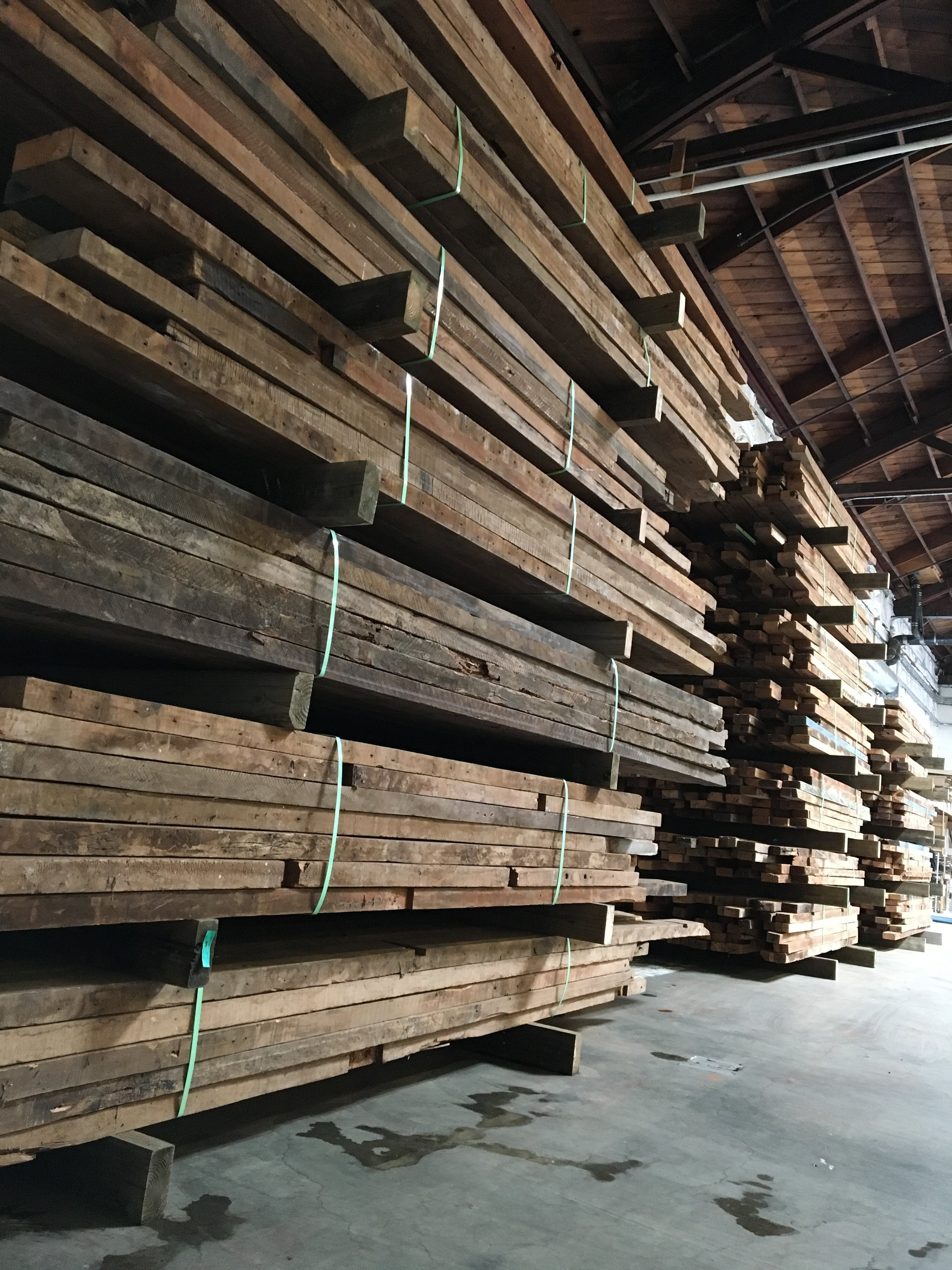 Stacks on stacks of reclaimed timbers and boards
