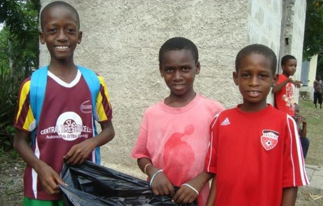 Kids and families participated in a community-wide clean up to prepare for the tournament