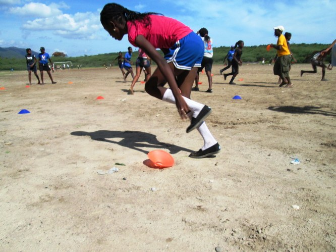 Girls in Anse a Veau learn a Coaches Across Continents health game