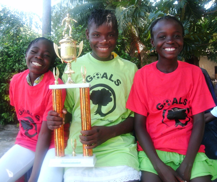 Esteri, on the right, shows off the trophy her team won in a national youth tournament in 2013.