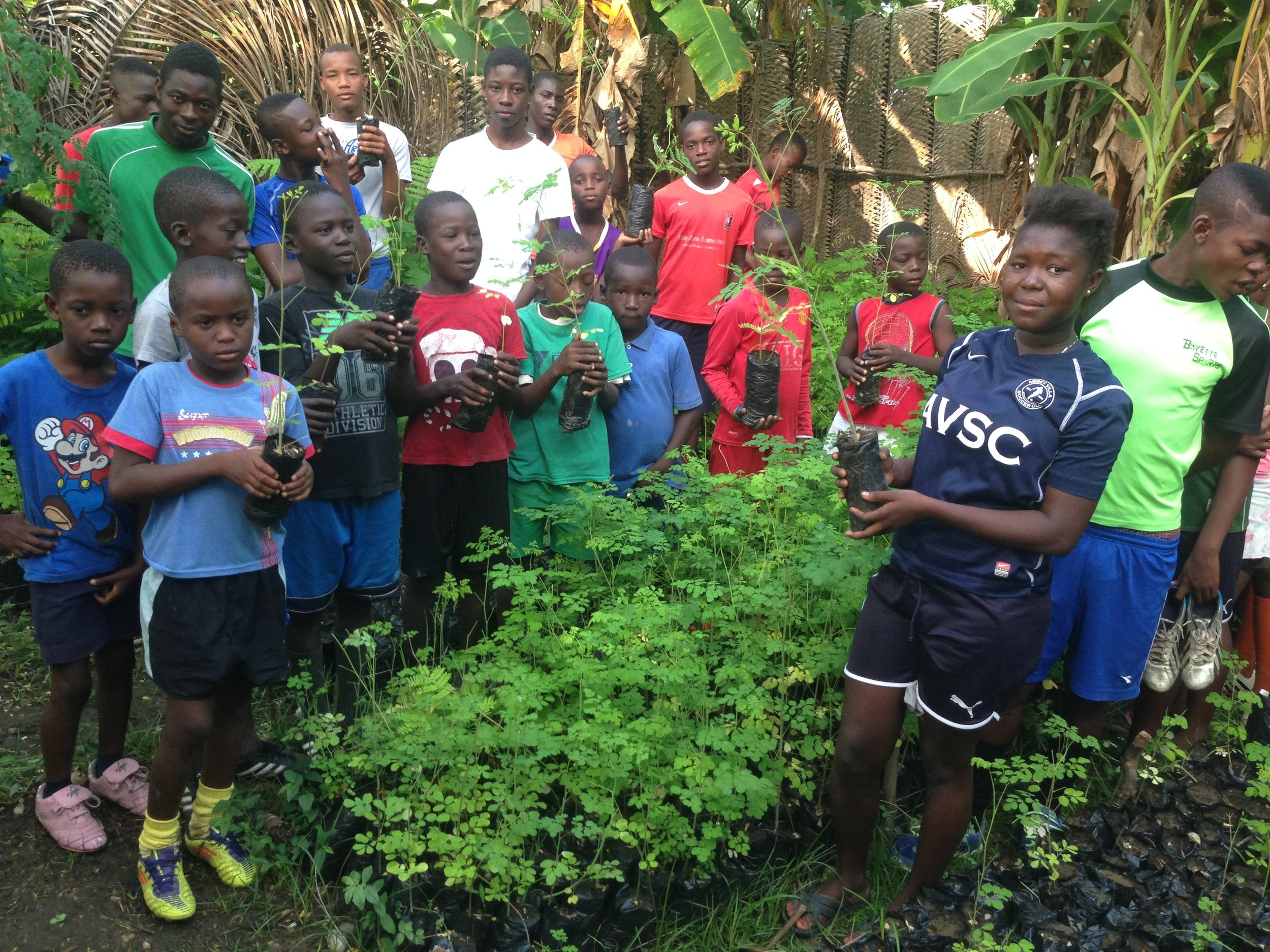 Kids in Bossan with their tree nursery