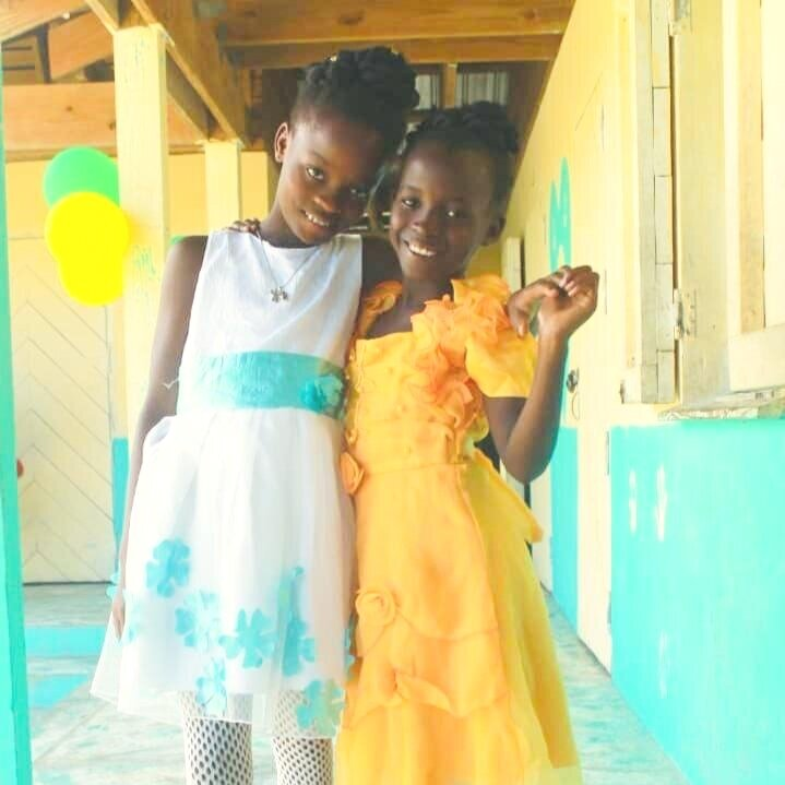 Two of the proud graduates from our Literacy Program in Destra