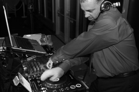 Brian Dale mixing music during a party.