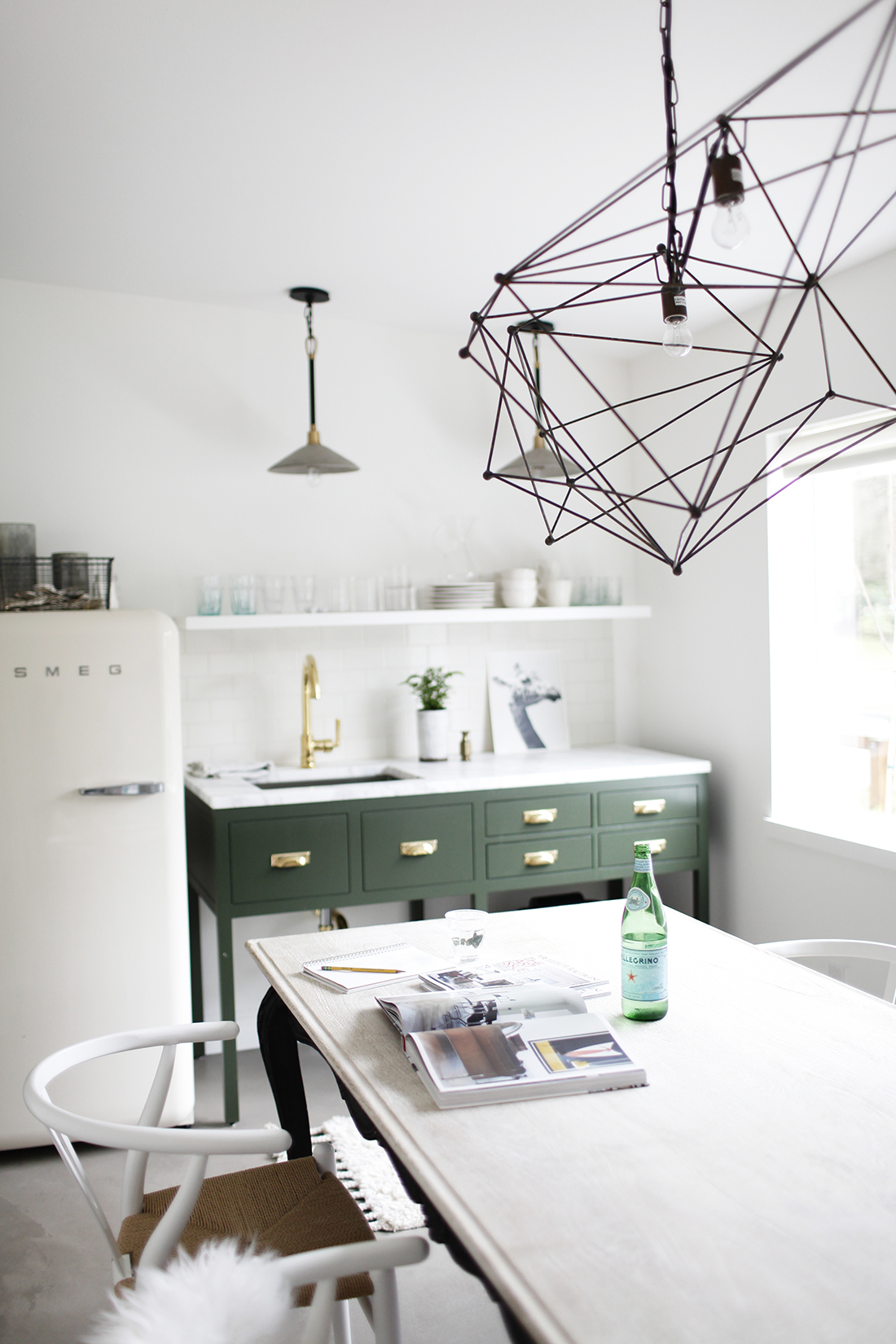 THE COMFORTS OF HOME - Katie wanted the office space to feel like her brand, timeless traditional details with modern lines and amenities. After placing the powder room, office desk, and a Smeg fridge, she had a given amount of space remaining to design and place a small kitchenette.