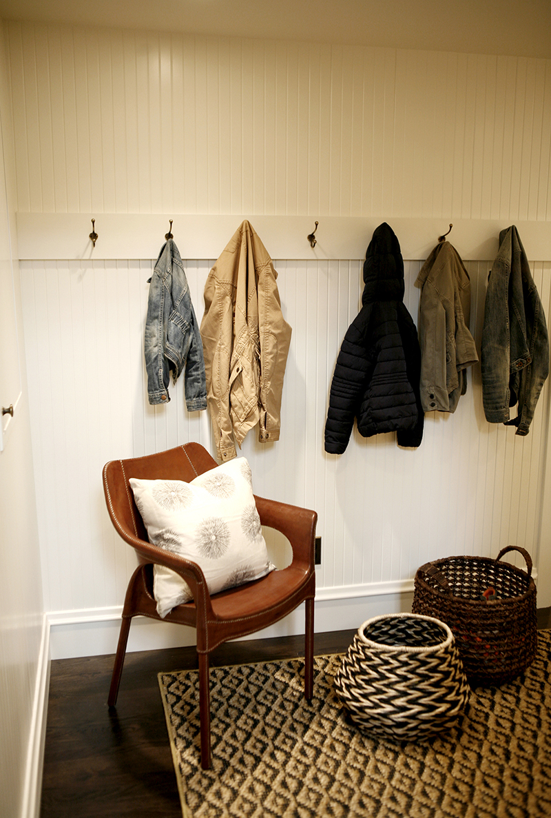 ORGANIZED CHAOS - Katie creates a convenient mudroom off the residence's private entrance for family members to drop their jackets, shoes, backpacks, and sports equipment.