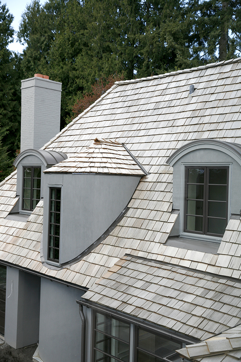 HIGH PITCHED - A noticeable trademark of tudor homes is their high-pitched rooflines. The team extends this strong architectural element into the new addition, and restores the old to match.