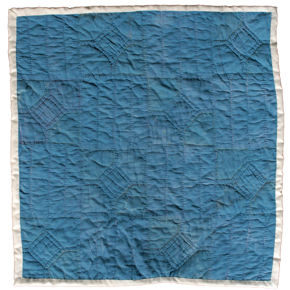 Reclaimed quilt, cut to size, spray-painted blue.