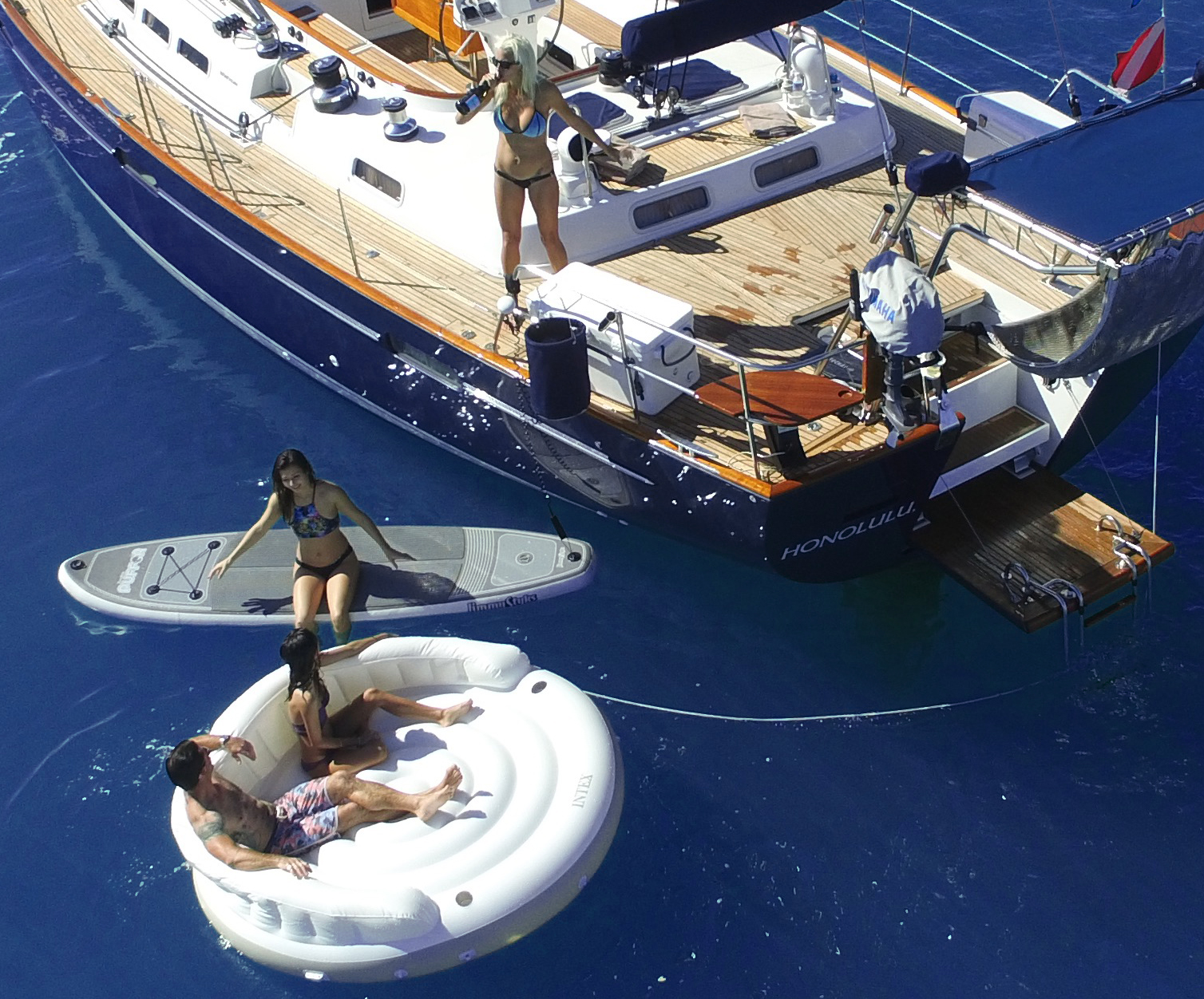 Snorkeling on yacht with SUP and lounge raft off waikiki