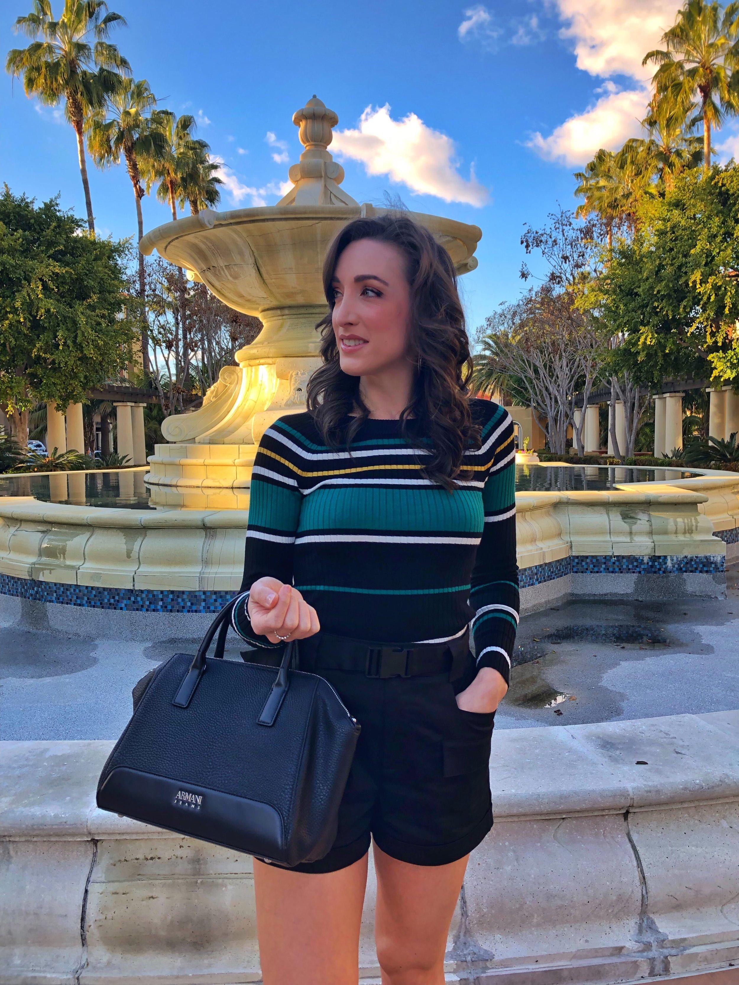 Olivia Culpo Express High Waisted Cargo Shorts. Black Leather Armani Tote. Beautiful San Diego day.