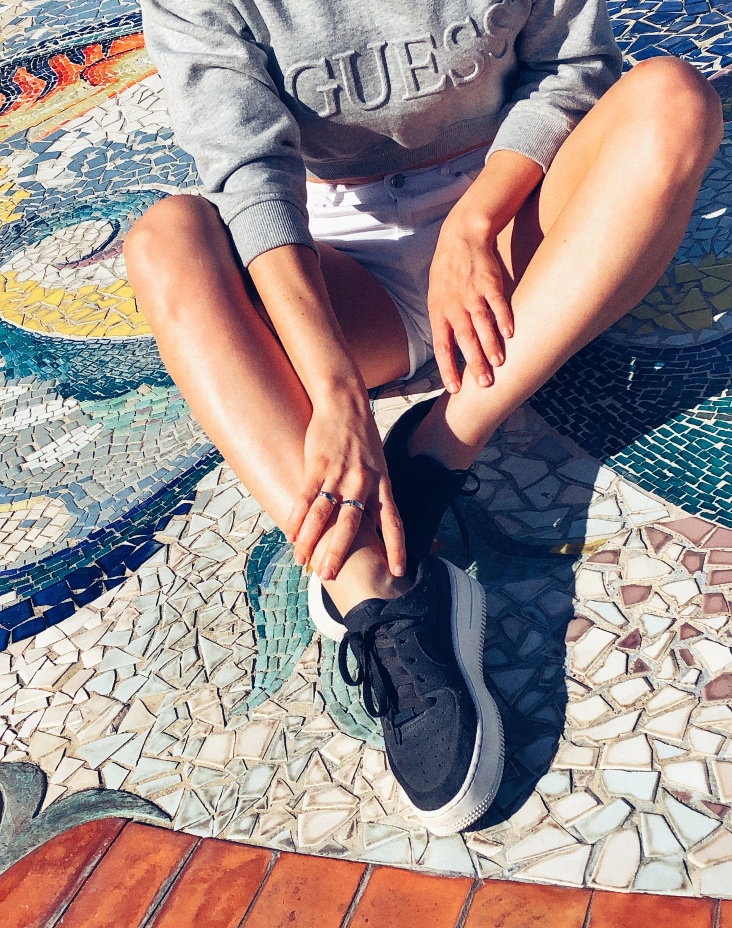 In the details. Nike Air Force 1 Sage Low and Guess Cropped Sweater. Mosaic on Shelter Island in San Diego, California.