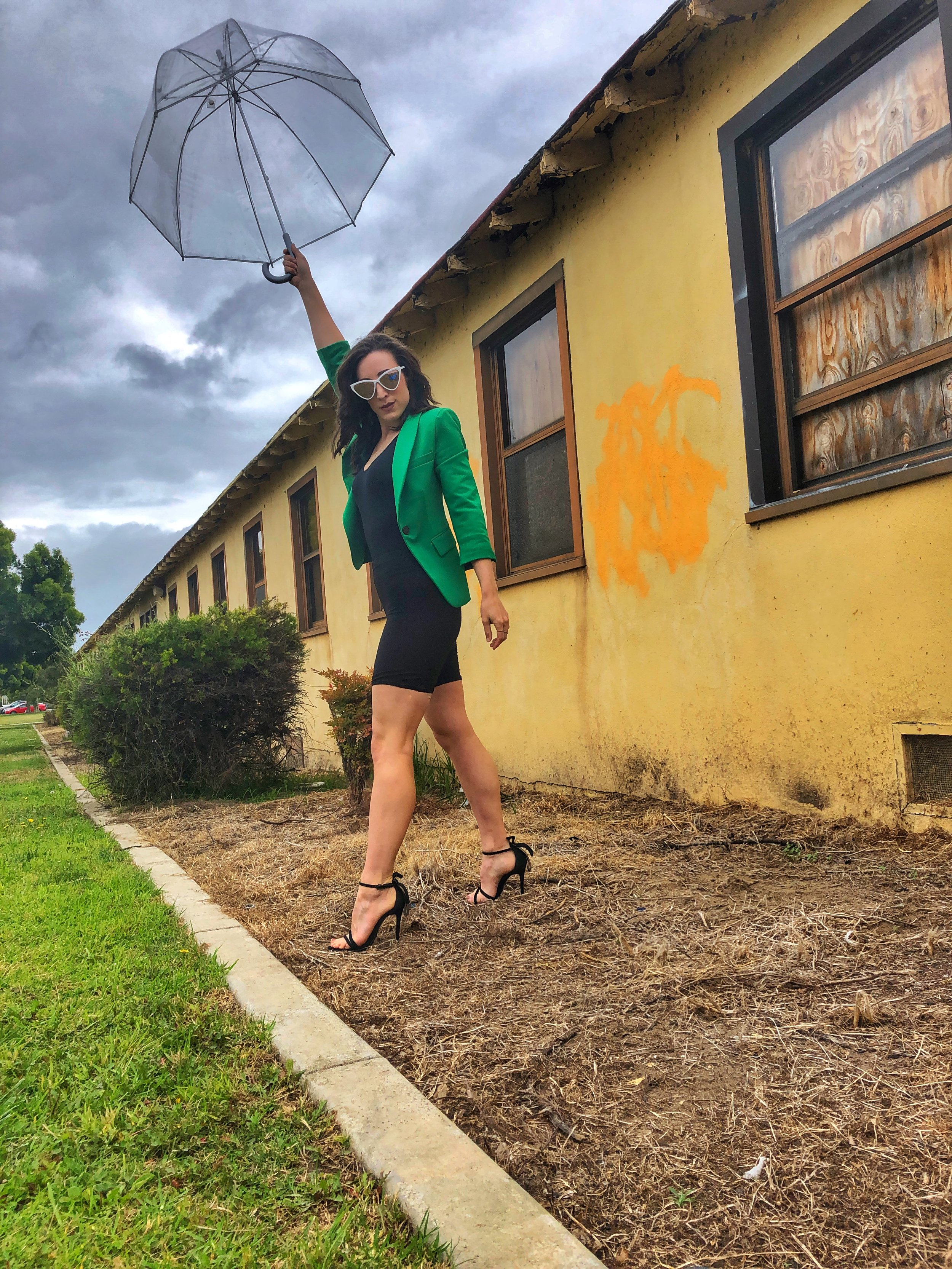 Totes Clear Umbrella. Green Blazer. Bike Shorts. Schutz heels.