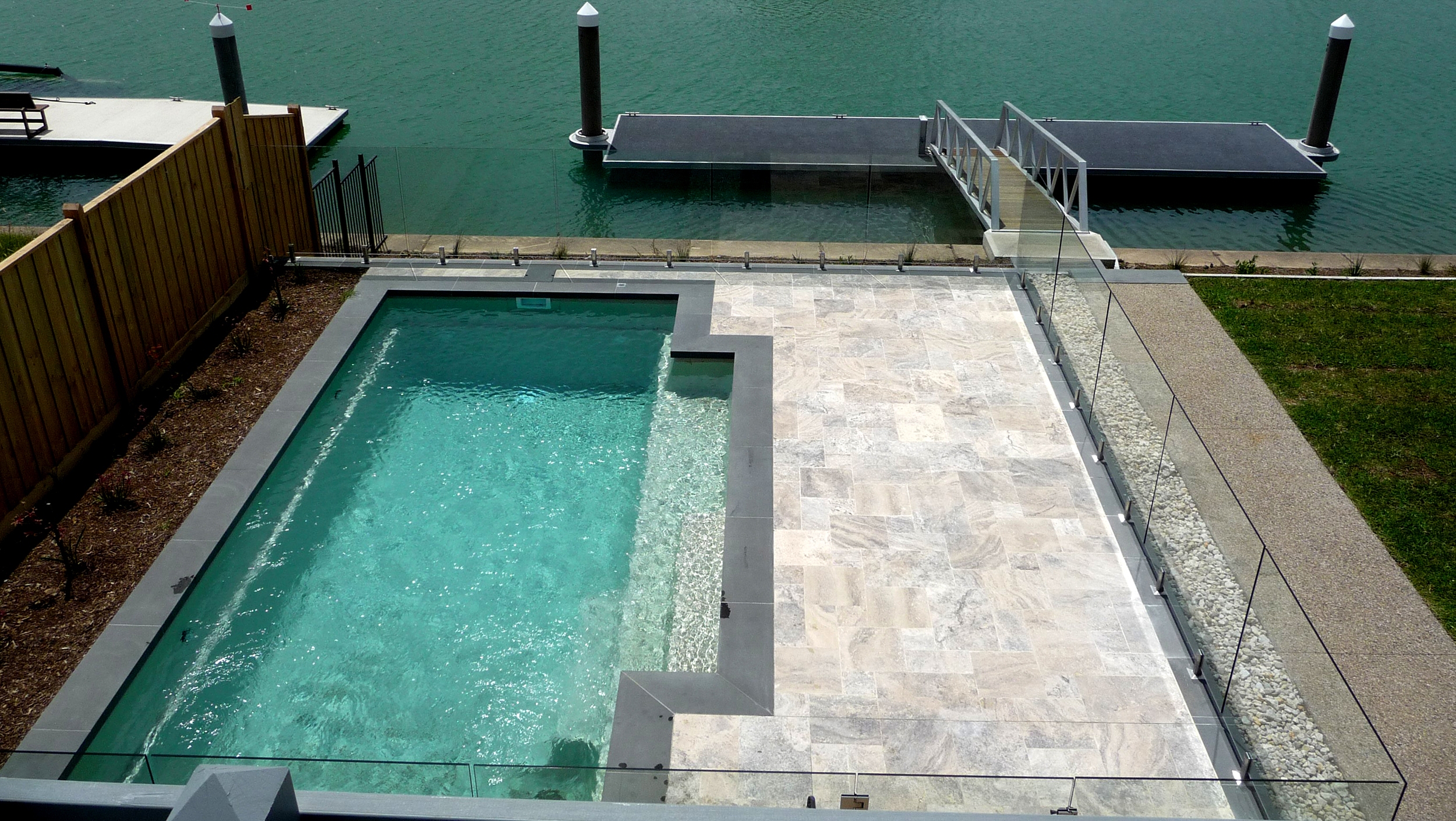 Silver Unfilled Travertine with Bluestone Copers around Pool
