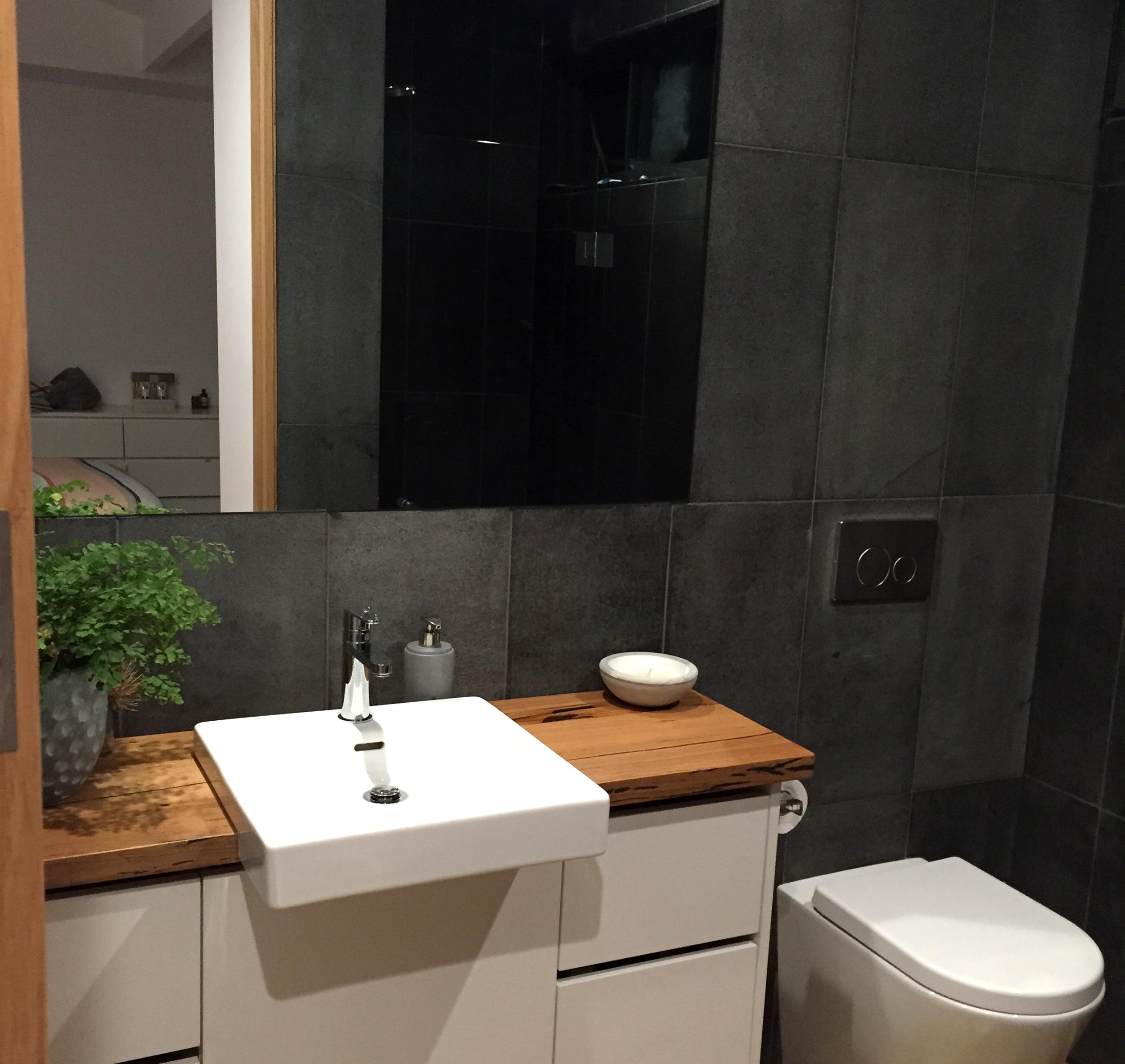 Sandblasted Black Granite on Bathroom Wall