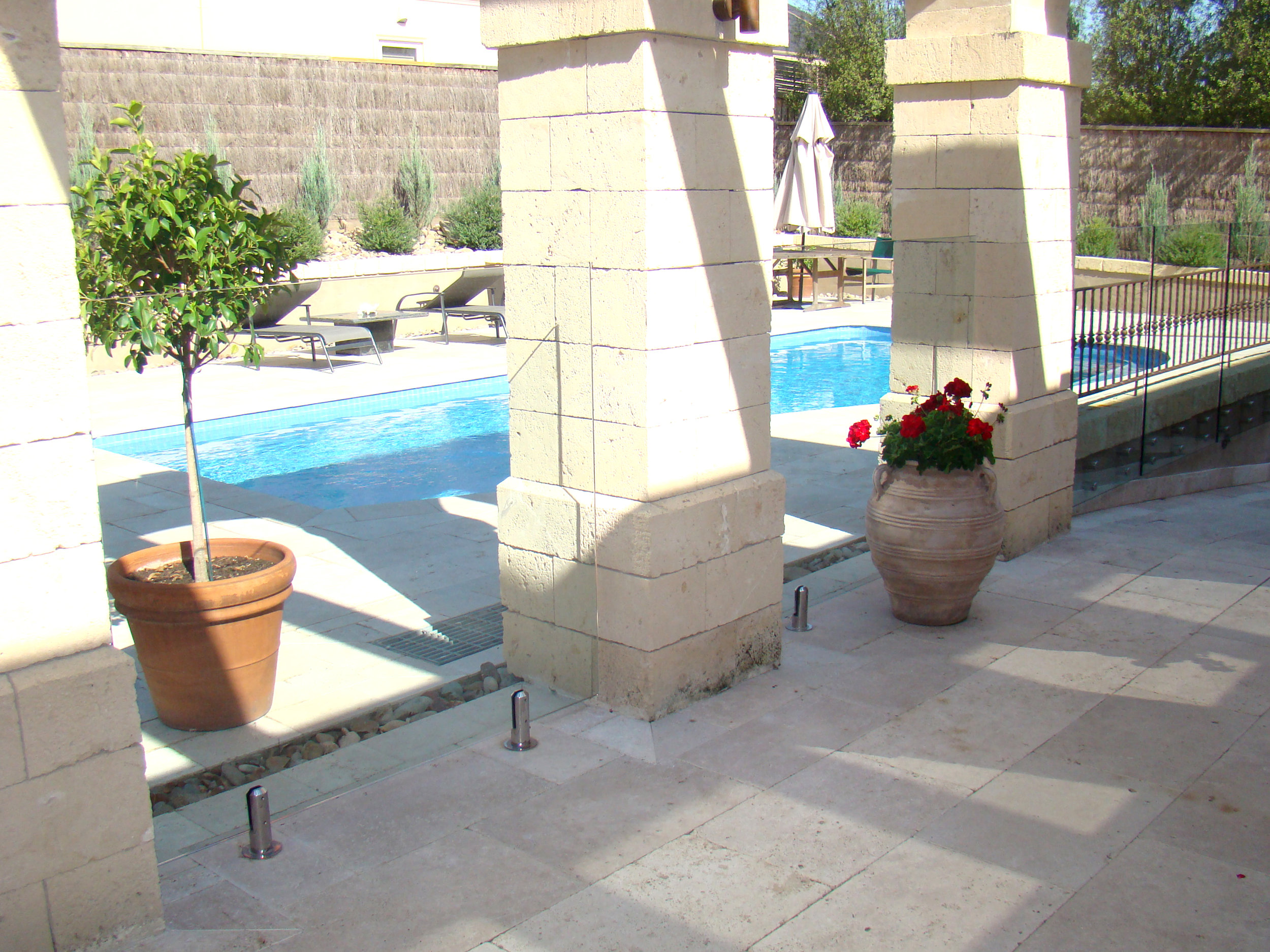 Classic Unfilled Travertine on Patio and Pool Area
