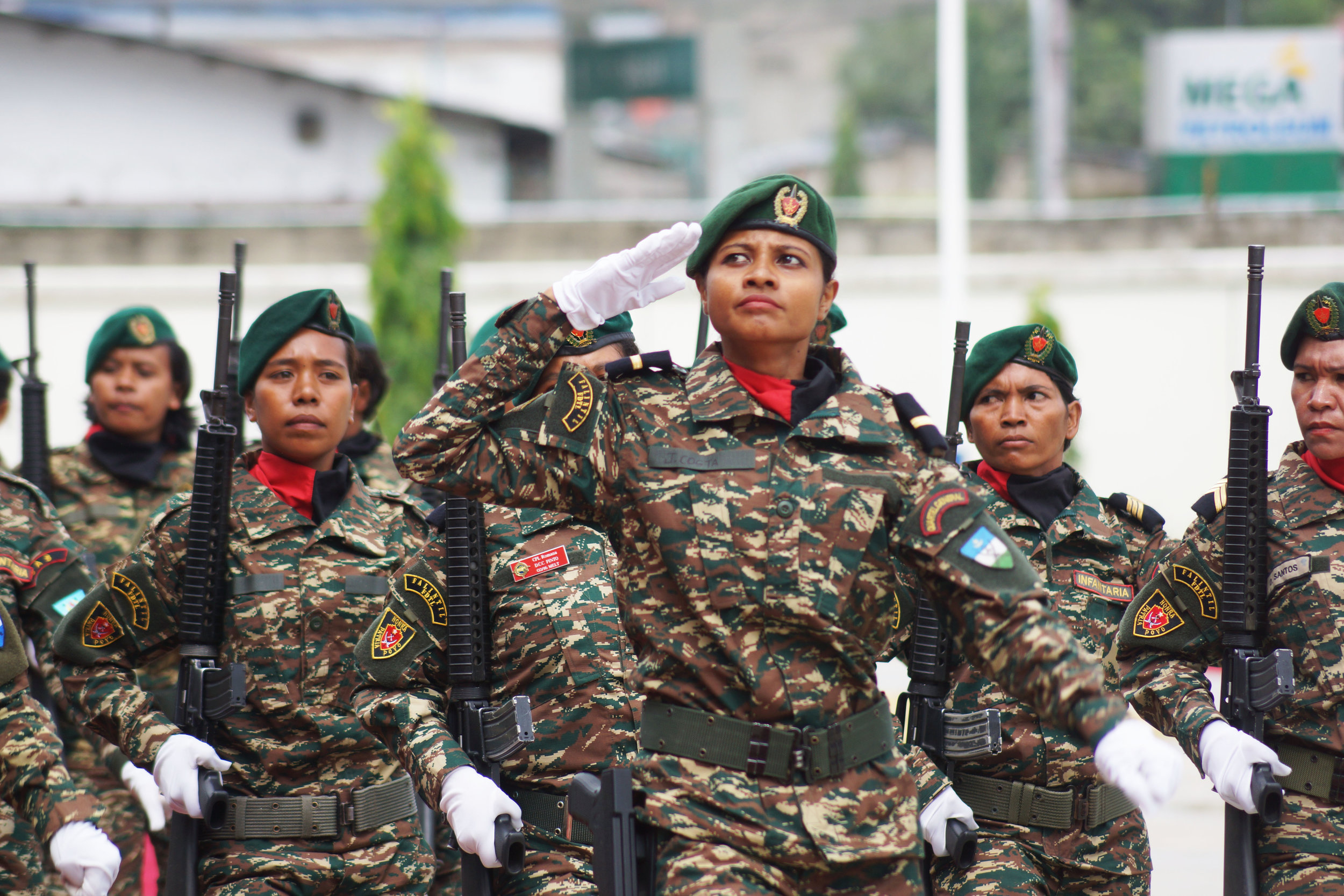 Female soldiers soluting President Francisco Guterres at a military parade celebrating the 17th anniverssary of the Timor Leste defense force. (Edward Cavanough, February 2, 2018, Dili).