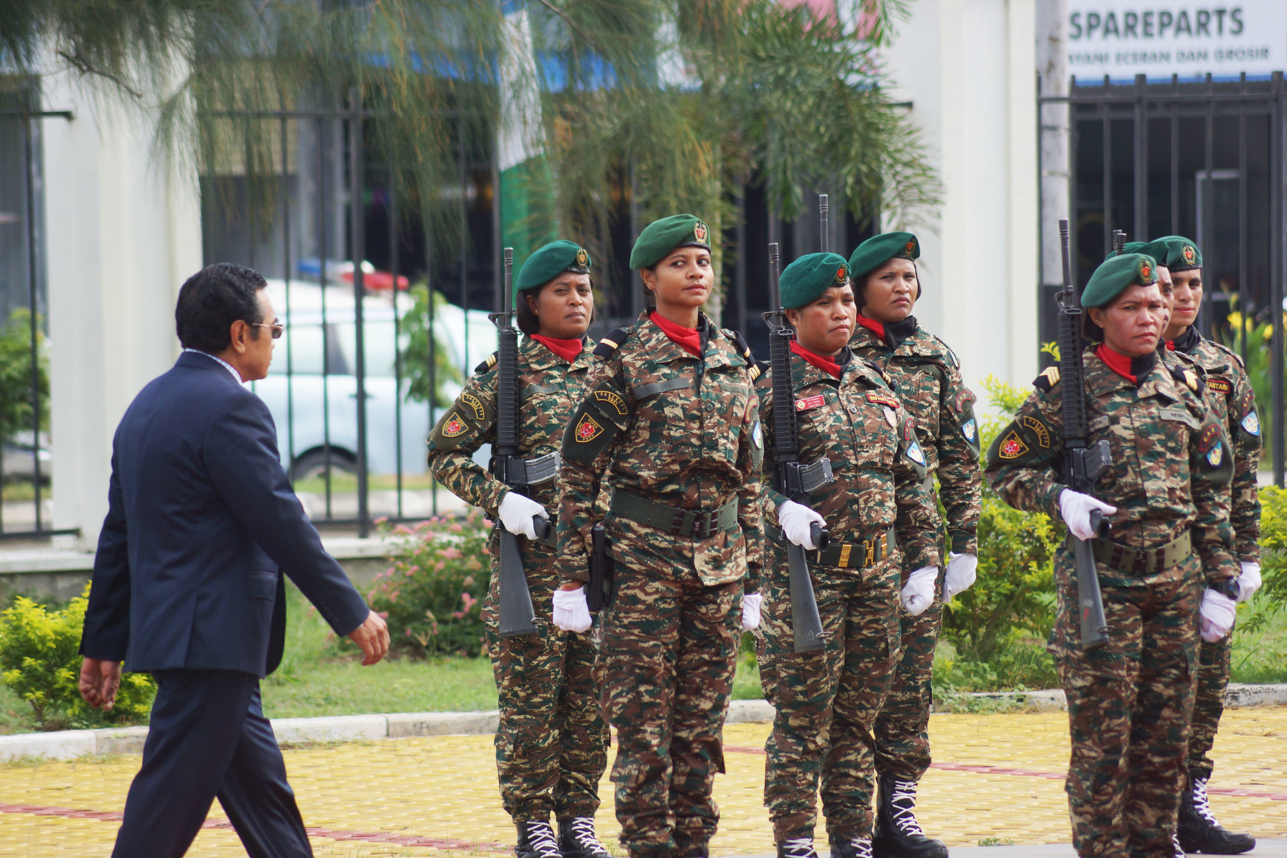 President Francisco Guterres marches past a group of female soldiers. (Edward Cavanough, February 2, 2018, Dili).