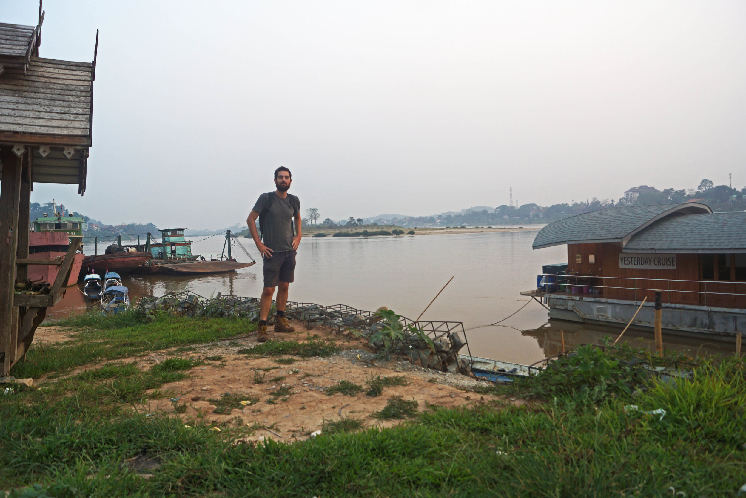 On the banks of the Mekong River in Huay Xai, Laos. Thailand in the background on the other side of the shore.