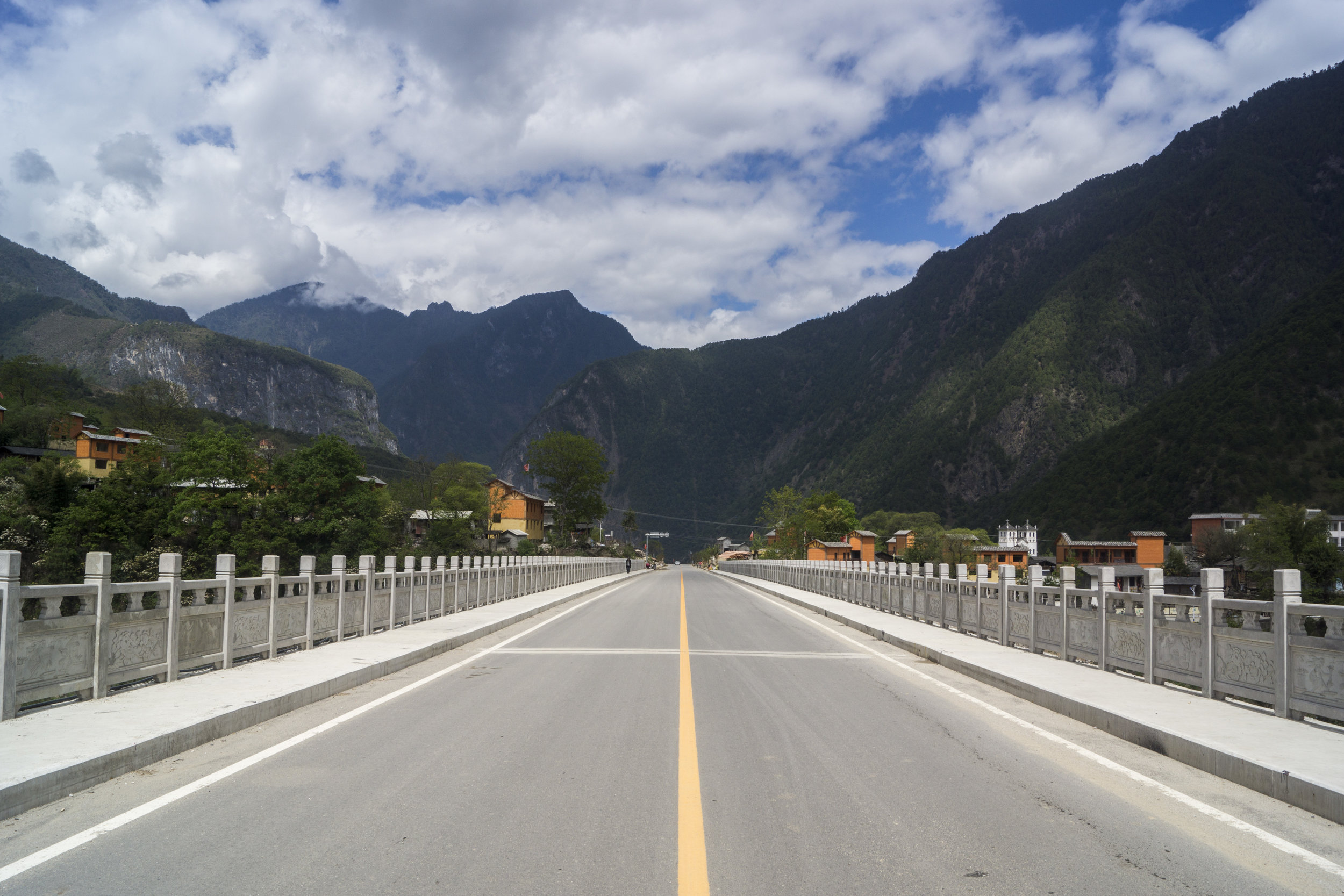 The new road to Tibet. A rare paved, completed section just outside of central Bingzhongluo.