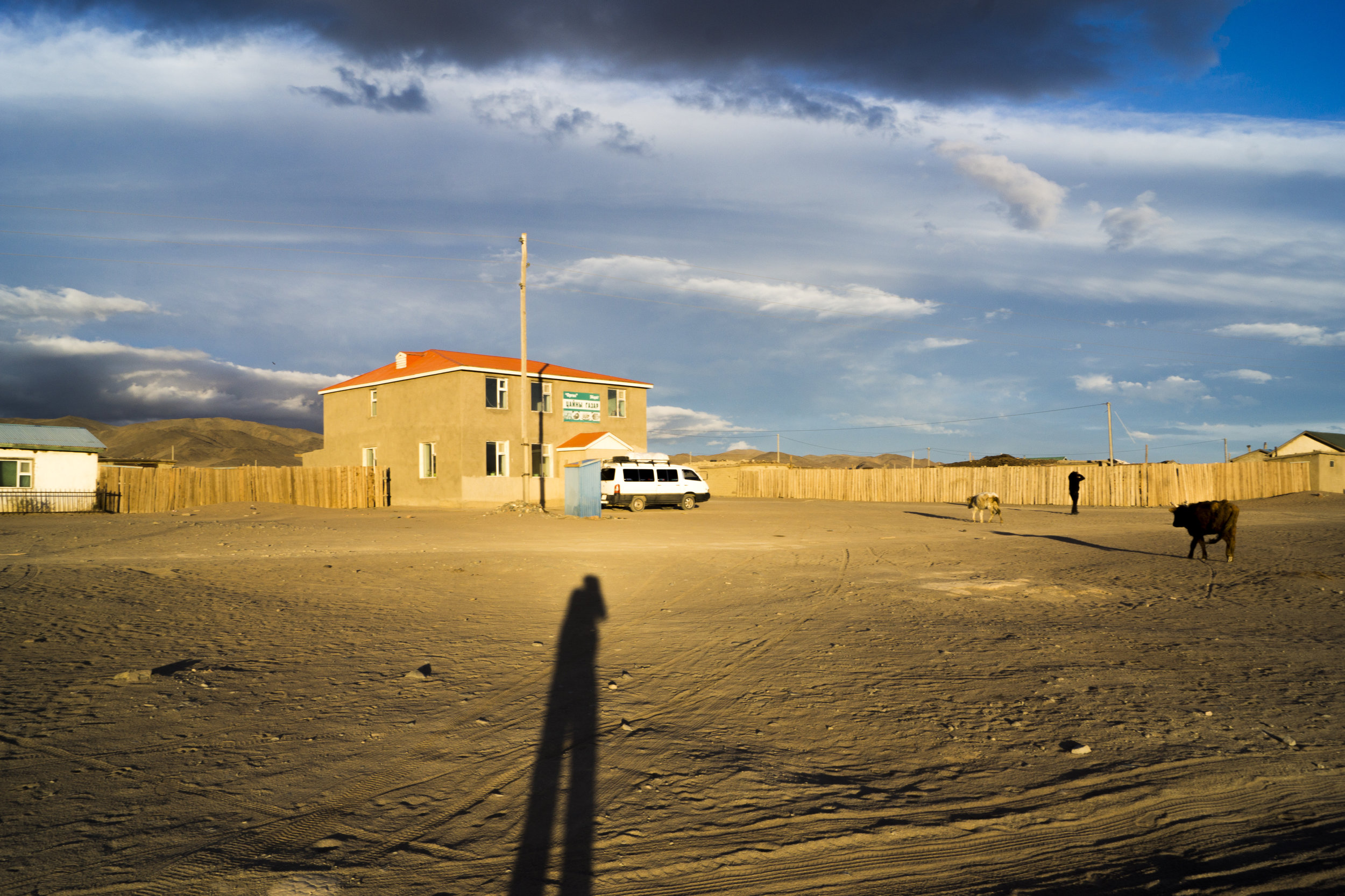 Uulgii, southern Ulaangom Province, just before sunset. The small minivan that brought me there at my shadow's end.