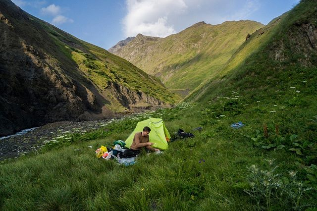 Camping amongst the wildflowers of Tusheti National Park. We pitched here just after a brutal river crossing. Were it not for the rope tied around my waste - held tight by two German hikers on the opposite bank - I (and my gear) would have been swept downstream. We trod to this spot with boots filled with water.