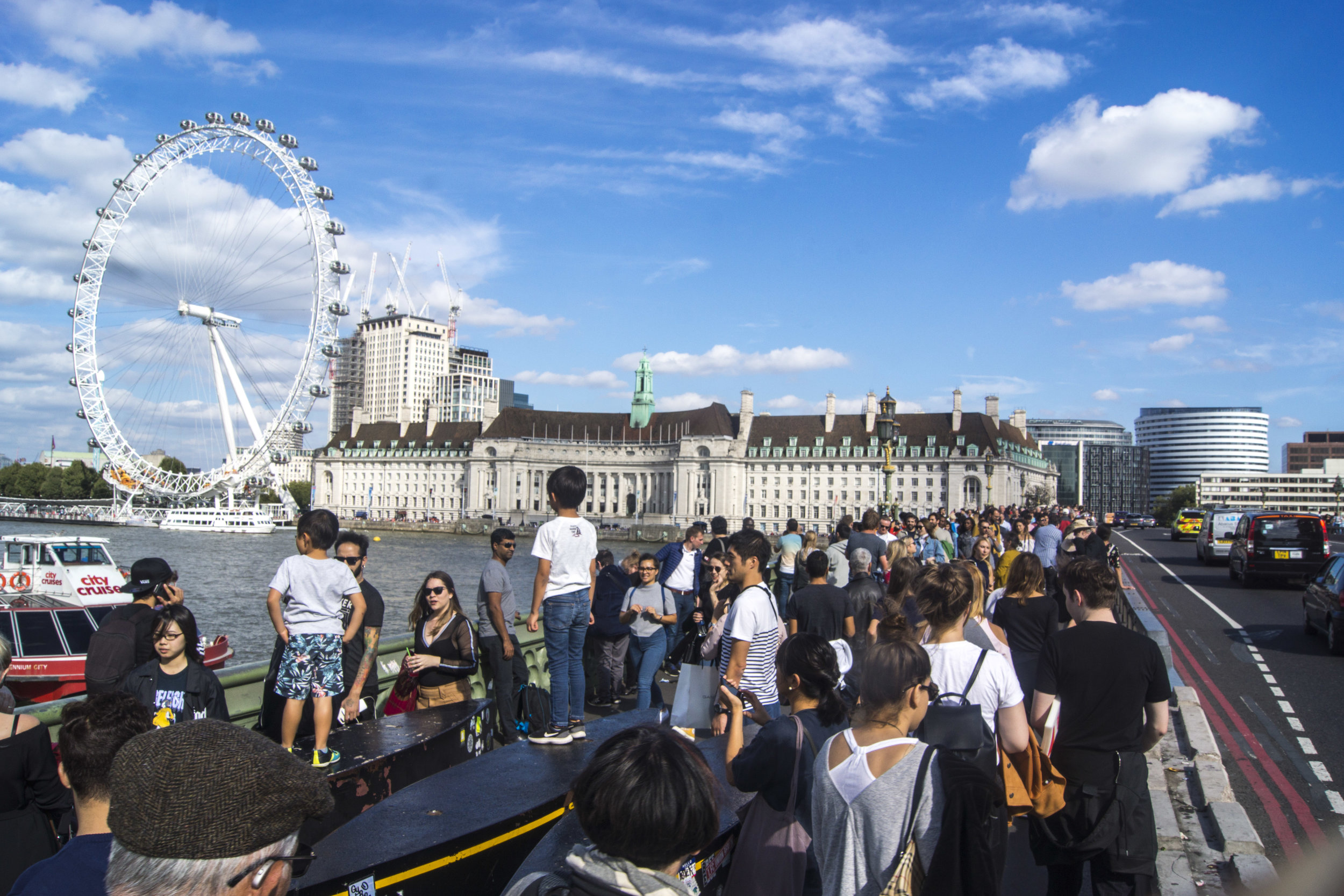 Westminster Bridge:  I found this a stirring site. The kids in the foreground are standing on barricades erected to prevent a terrorist attack like the one that killed 6 people here in 2017. Instead of cowering, the multicultural British community carry on, relishing in the sunshine, and utilising the barricades as a viewing platform.