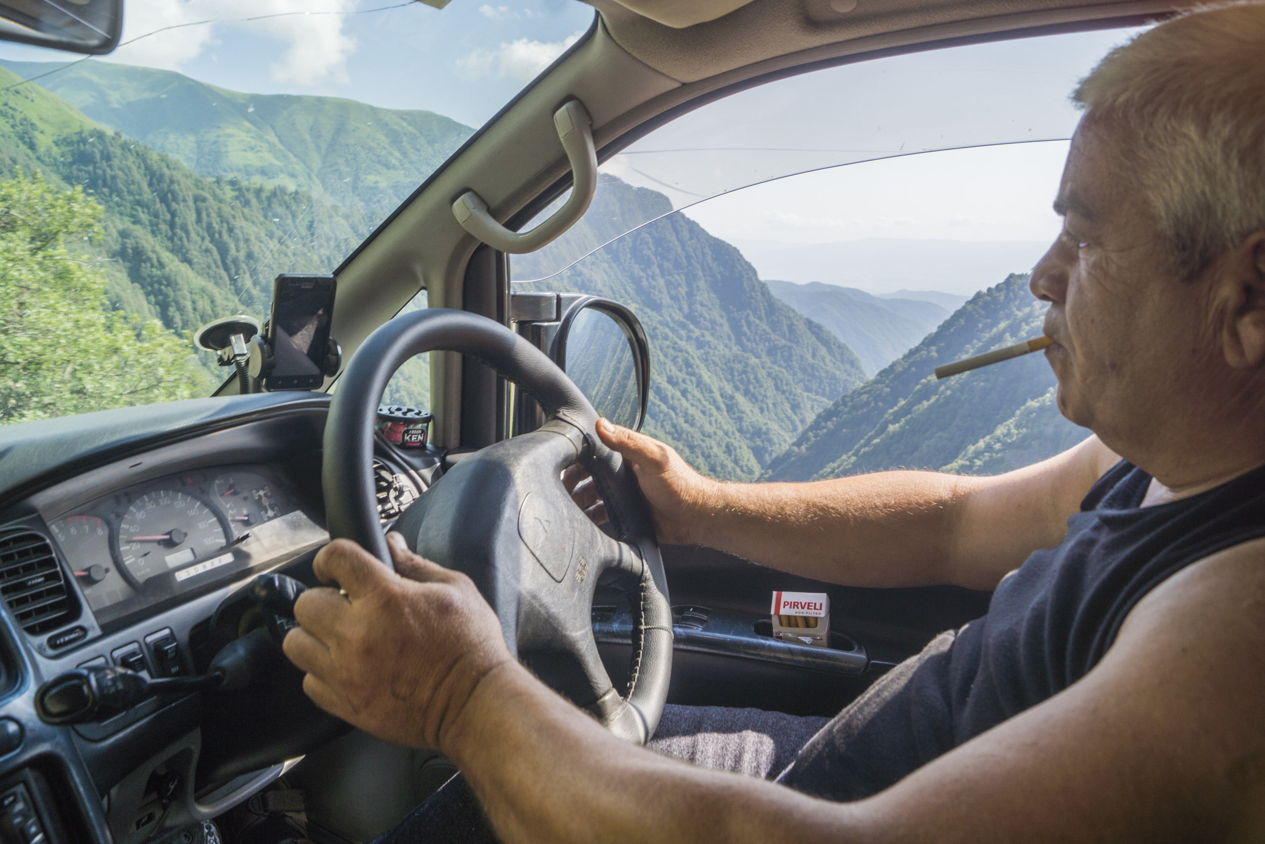 Letting go in Georgia:  Often during the trip, my fate was in the hands of others. Here, I get a lift up one of the world's most dangerous roads, in Georgia.