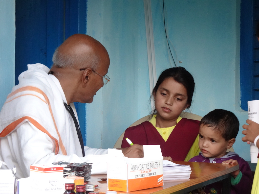 girl with her sister at school medical examination