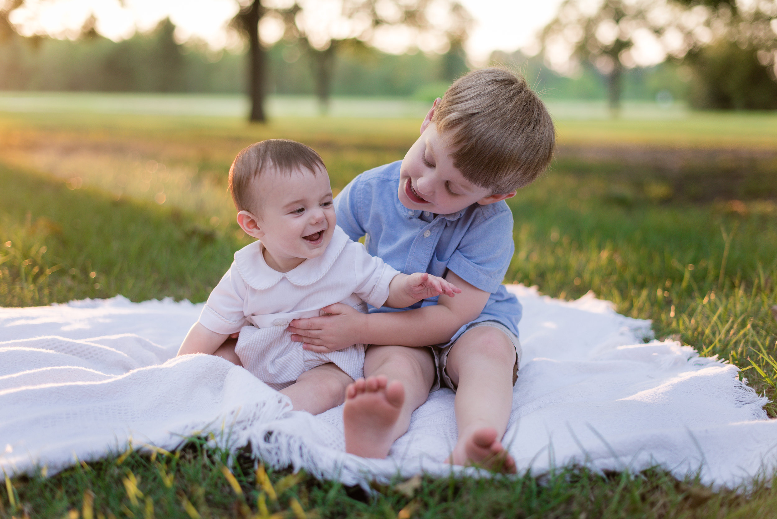 baby brother and big brother hugging, louisiana family photography