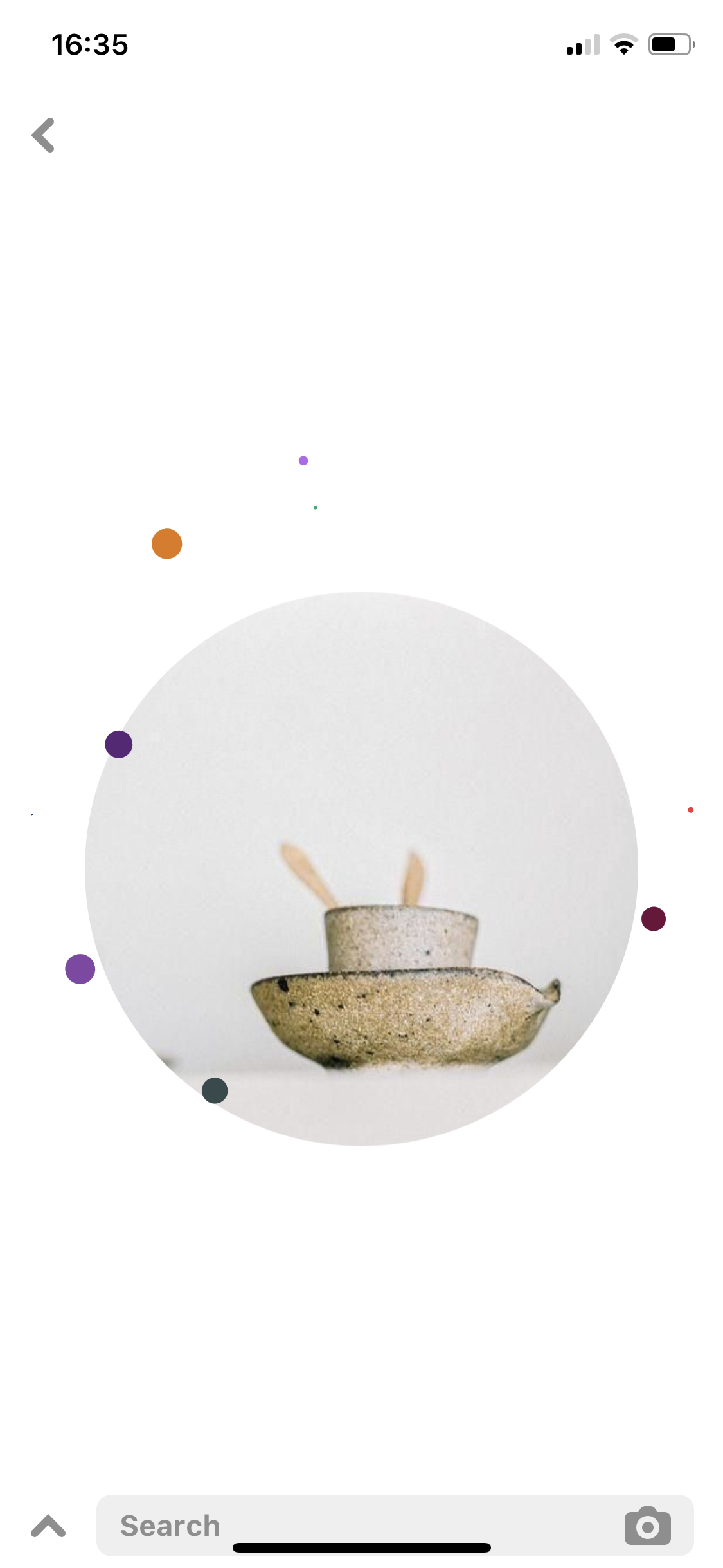 Screenshot of a Pinterest app looking for a photo related to ceramic bowl
