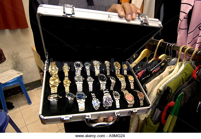 vendor-shows-case-of-fake-rolex-watches-for-sale-in-the-back-of-his-a9mg24.jpg