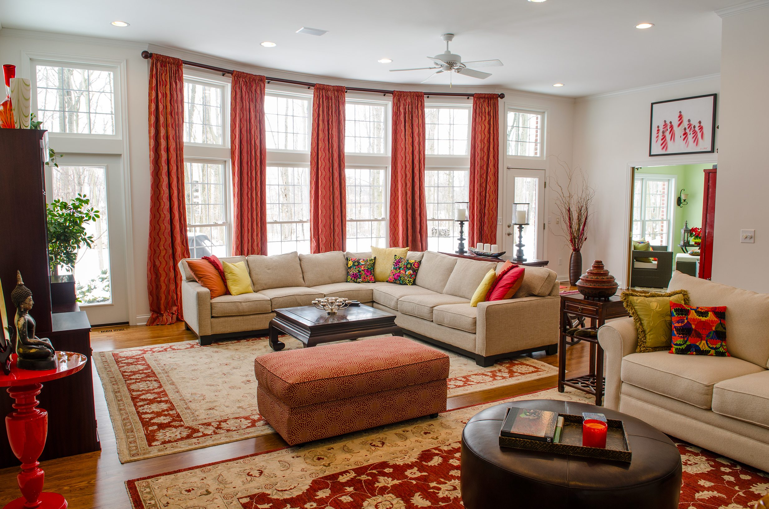 Modern living room with stylish curtains and painting hanging on the wall