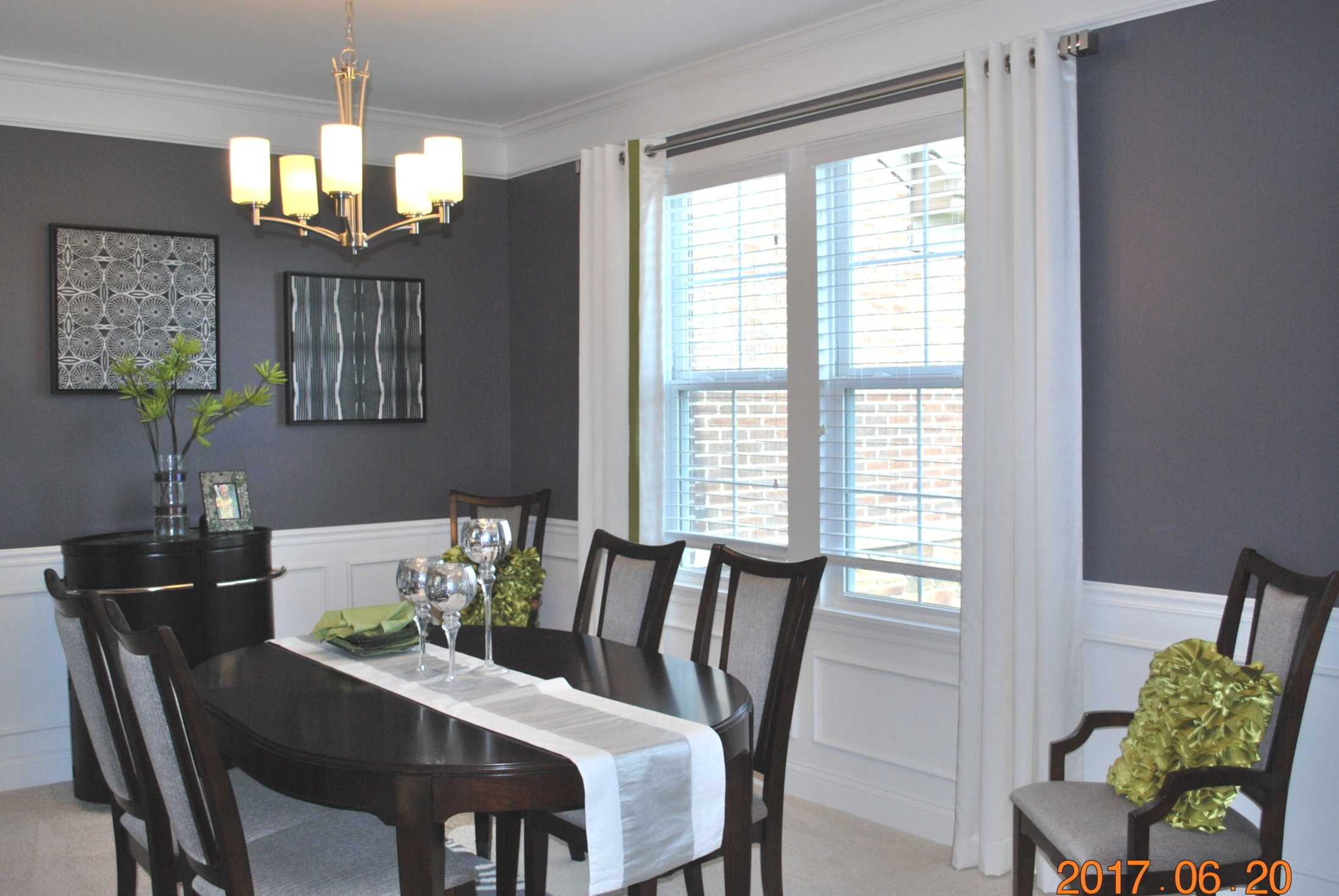 Light painted dining room with wooden chairs and table