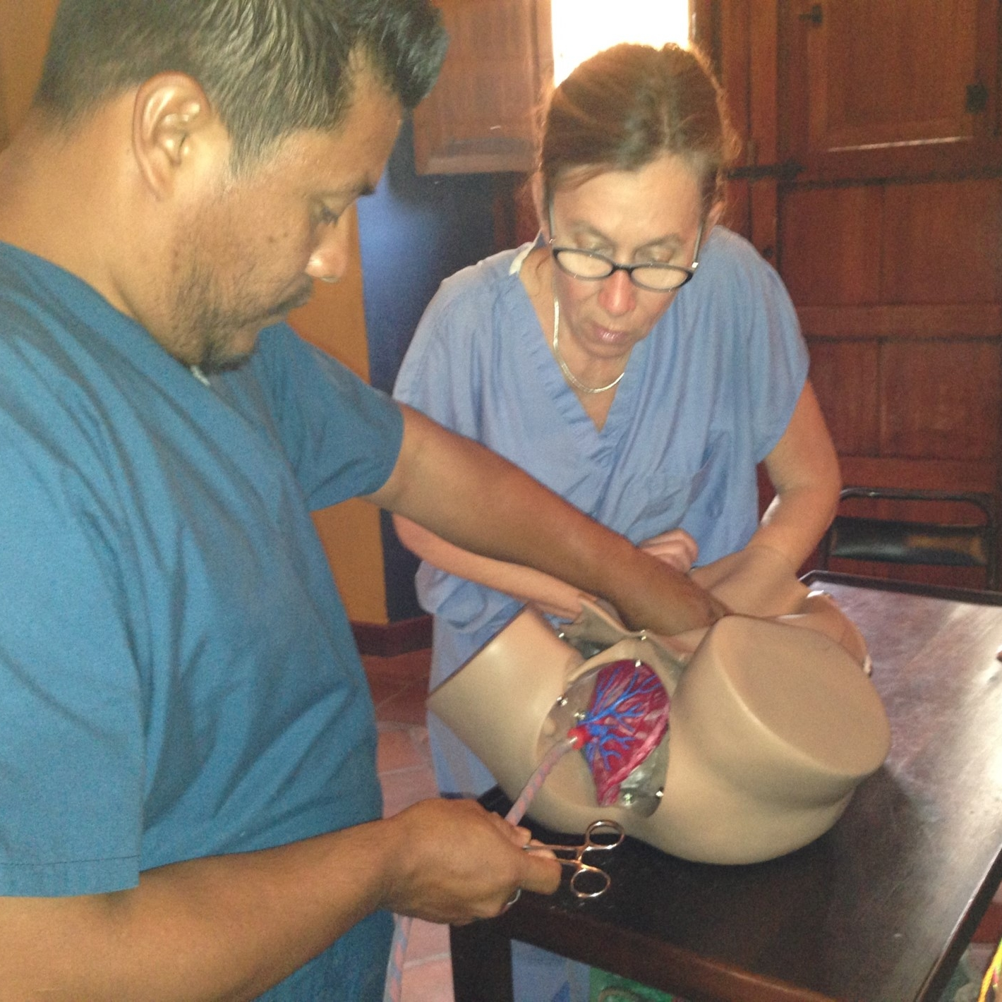 Dr. Antonia Nicosia observes a medical student through hands-on simulation in Nicaragua.